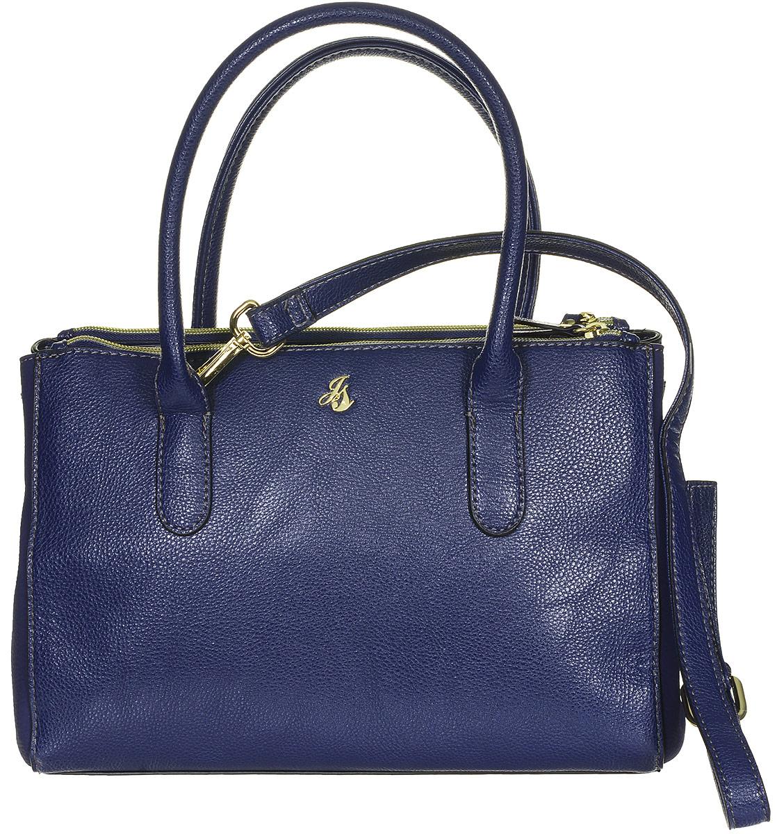 Сумка женская Jane Shilton, цвет: темно-синий. 21832183navyСтильная женская сумка Jane Shilton не оставит вас равнодушной благодаря своему дизайну и практичности. Она изготовлена из качественной искусственной кожи зернистой текстуры и оформлена металлической пластинкой с логотипом бренда. Сумка имеет два вместительных кармана на молнии. На тыльной стороне расположен удобный накладной карман, который закрывается на магнитную кнопку. Изделие оснащено удобными ручками и съемным плечевым ремнем, длина которого регулируется с помощью пряжки. Сумка закрывается на замок-молнию. Внутри расположено главное отделение, которое содержит один открытый накладной карман для телефона, один вшитый карман на молнии для мелочей, четыре кармана для визиток и карт и два фиксатора для письменных принадлежностей. Такая модная и практичная сумка завершит ваш образ и станет незаменимым аксессуаром в вашем гардеробе.