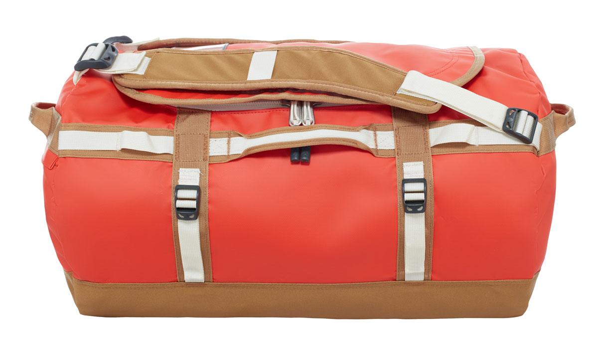 Сумка дорожная The North Face Base Camp Duffel, цвет: оранжевый. T0CWW3LJG, 50 лT0CWW3LJGНаш уникальный невероятно прочный баул для экспедиций, покоривший сердца поклонников в разных странах мира, теперь стал еще лучше! Емкость 50 литров позволяет упаковать всю нужную одежду и снаряжение. Усовершенствованные эргономичные плечевые лямки препятствуют перекручиванию изделия, предоставляя комфорт в течение длительного времени, а новые боковые ручки с наполнителем позволяют носить изделие как на плече, так и в руках. В боковом кармане на молнии можно разместить телефон и документы для легкого доступа в пути, а конструкция из прочного ламинированного баллистического нейлона обеспечит надежность в любой ситуации.