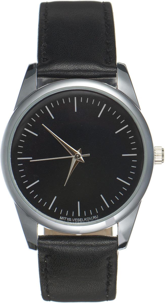 Часы наручные мужские Mitya Veselkov Классика, цвет: черный. MV-076MV-076Оригинальные часы Mitya Veselkov Классика понравятся вам с первого взгляда. Корпус часов выполнен из стали, и дополнен задней крышкой. В центре корпуса располагаются круглые кварцевые часы с тремя стрелками. Циферблат выполнен в классическом стиле. Часы оснащены кожаным ремешком, который фиксируется с помощью пряжки. Часы упакованы в фирменную упаковку в виде стакана. Такие часы станут отличным подарком человеку, любящему качественные и оригинальные вещи.