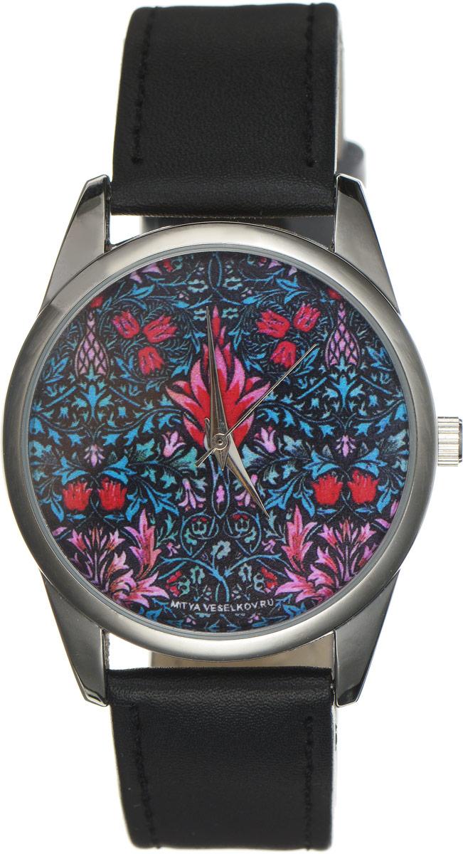 Часы наручные женские Mitya Veselkov Тюльпаны, цвет: черный, мультиколор. Арт. MV-174MV-174Оригинальные часы Mitya Veselkov Тюльпаны понравятся вам с первого взгляда. Корпус часов выполнен из стали, и дополнен задней крышкой. В центре корпуса располагаются круглые кварцевые часы с тремя стрелками. Циферблат оформлен оригинальным принтом с изображением цветов. Часы оснащены кожаным ремешком, который фиксируется с помощью пряжки. Часы упакованы в фирменную упаковку в виде стакана. Такие часы станут отличным подарком человеку, любящему качественные и оригинальные вещи.