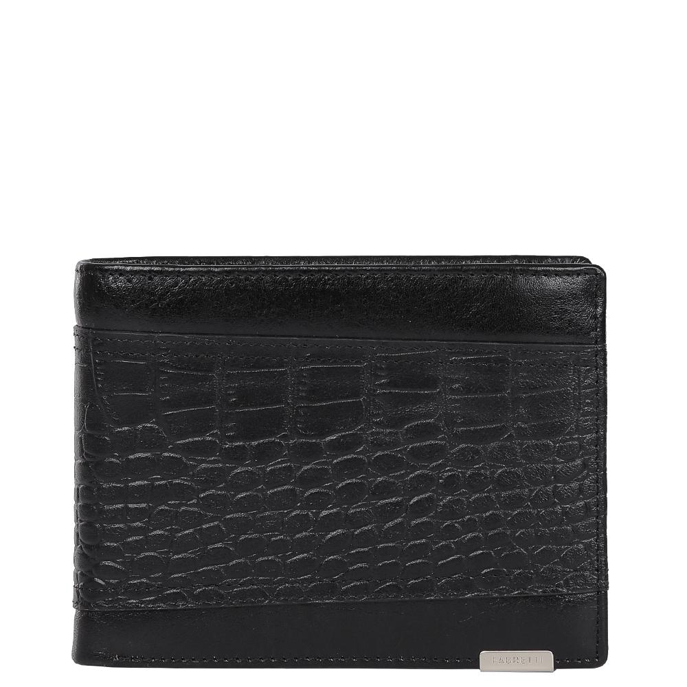 Кошелек мужской Fabretti, цвет: черный. 36011-black36011-blackЭлегантный мужской кошелек от итальянского бренда Fabretti выполнен из натуральной кожи с дизайнерским тиснением под рептилию. Насыщенный черный цвет и фурнитура, выполненная в серебряном цвете, превратили аксессуар в модное изделие, которое подчеркнет ваше уникальное чувство стиля. Внутри модели имеется три отделения для купюр, одно из которых закрывается на молнию. Вы с легкостью сможете расположить 8 дисконтных и кредитных карточек, любимую фотографию, а также всю мелочь с помощью удобного кармана. Кошелек закрывается на прочную застежку.