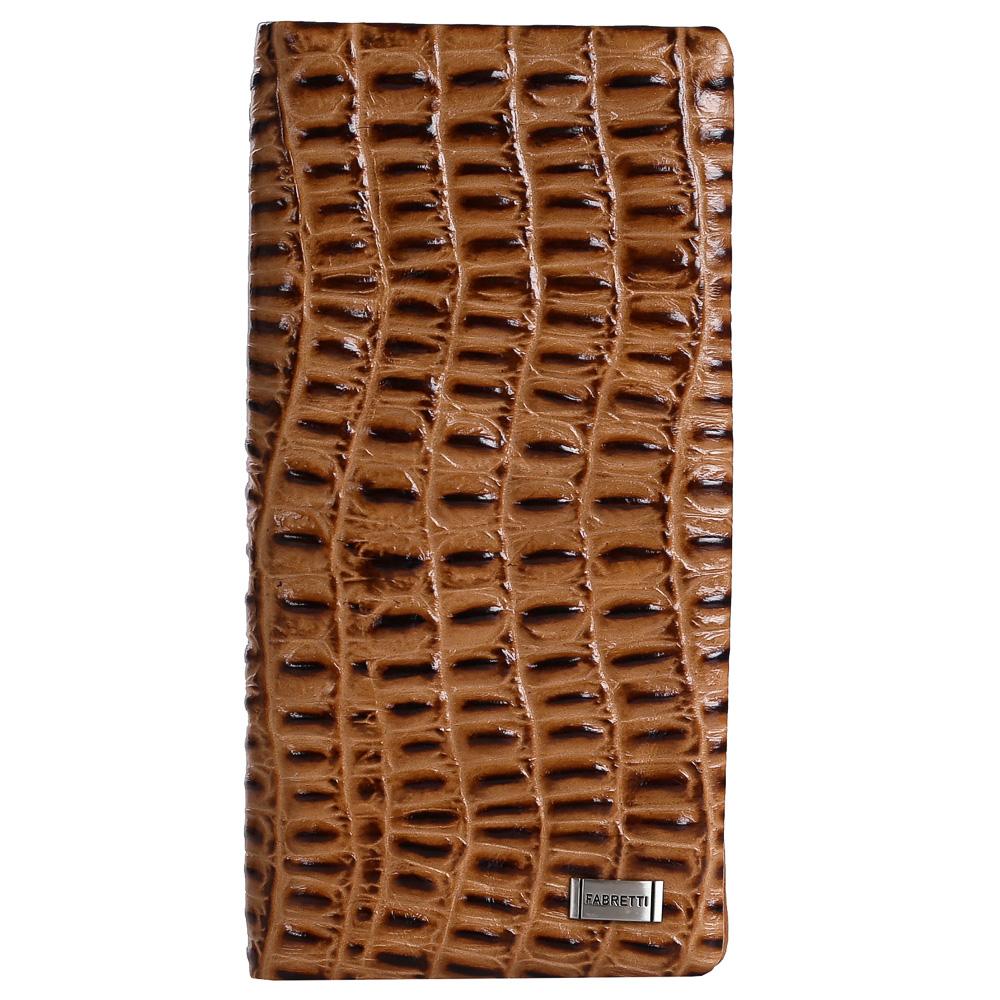 Кошелек женский Fabretti, цвет: коричневый. 73039-tan cocco73039-tan coccoРоскошный женский кошелек от итальянского бренда Fabretti выполнен из натуральной мягкой кожи с роскошным тиснением под рептилию. Утонченный коричневый черный цвет и изысканная фурнитура под серебро подчеркнут ваш женственный и неповторимый стиль. Внутри изделия находятся два отделения для купюр. Вы с легкостью сможете расположить свои кредитные и дисконтные карты с помощью 12 отделений, а также одну любимую фотографию. Закрывается аксессуар на прочную и удобную кнопку.
