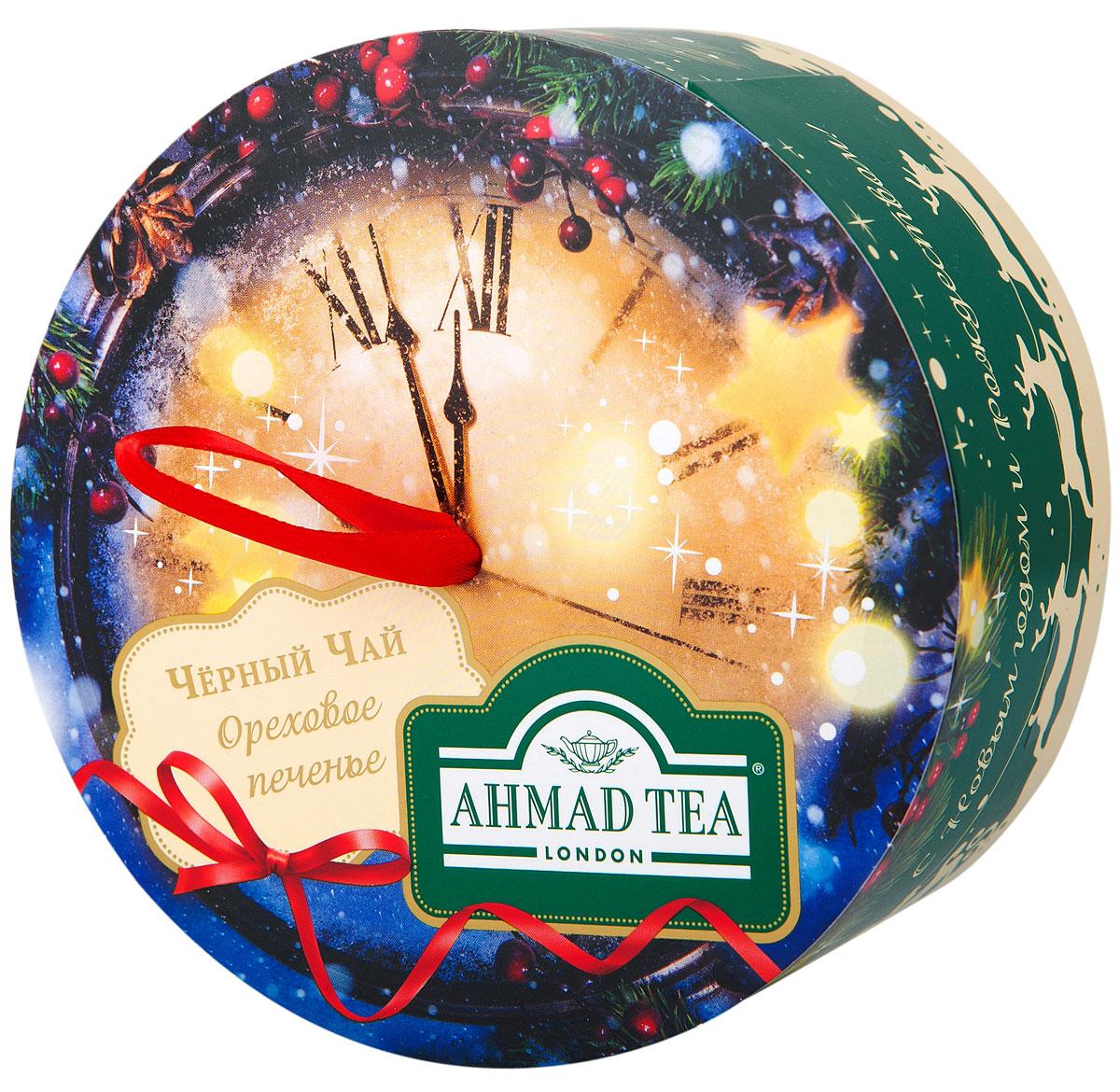 Ahmad Tea Новогодняя ночь черный листовой чай с лесным орехом, 60 гN068Чай черный байховый листовой Новогодняя ночь со вкусом и ароматом орехового печенья. Благородный вкус черного чая с высокогорных плантаций Индии и Цейлона приобретает особенную выразительность в сочетании с тонким ореховым послевкусием. Сладкая нота лесного ореха смягчает классическую терпкость черного чая и придает десертное звучание этому изысканному купажу.