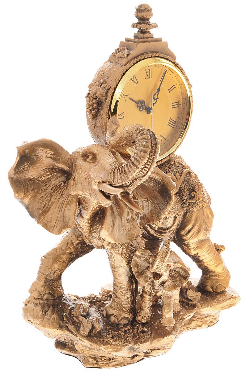 Часы настольные Русские Подарки Слоны, 32 х 19 х 47 см59375Настольные кварцевые часы Русские Подарки Слоны изготовлены из прочного полистоуна. Изделие выполнено в виде двух слонов. Циферблат круглой формы расположен на спине большого слона и оформлен римскими цифрами. Настольные часы Русские Подарки Слоны прекрасно оформят интерьер дома или рабочий стол в офисе. Часы работают от одной батарейки типа АА мощностью 1,5V (не входит в комплект). Размер изделия: 32 х 19 х 47 см. Диаметр циферблата: 13,5 см.