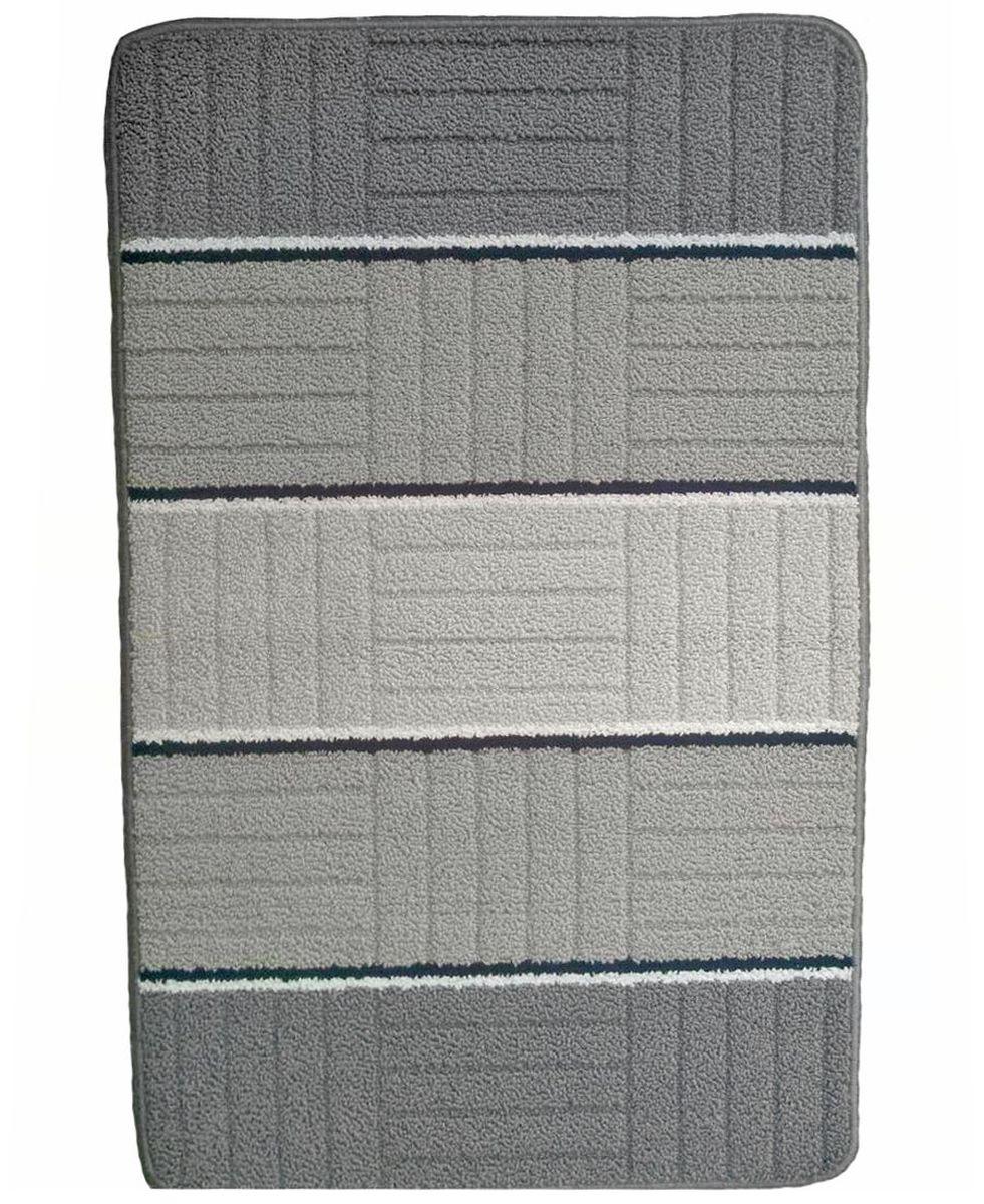 Коврик для ванной Kamalak Tekstil, цвет: серый, 60 x 100 см. УКВ-1002УКВ-1002Ковры-паласы выполнены из полипропилена. Ковры обладают хорошими показателями теплостойкости и шумоизоляции. Являются гиппоалергенными. За счет невысокого ворса ковры легко чистить. Вам придется по душе широкая гамма цветов и возможность гармонично оформить интерьер. Практичный и устойчивый к износу ворс - от постоянного хождения не истирается, не накапливает статическое электричество. Структура волокна в полипропиленовых моделях гладкая, поэтому грязь не может выесться, на ворсе она скапливается с трудом. Полипропилен не впитывает влагу, отталкивает водянистые пятна. Уход: Самый простой способ избавить изделие от грязи – пропылесосить его с обеих сторон (лицевой и изнаночной). Влажная уборка с применением шампуней и моющих средств не противопоказана. Если шерсти и шёлку универсальные чистящие составы не подходят, то для синтетики они придутся в самый раз. Хранить их нужно рулоном, не складывая «салфеткой». При надлежащем уходе синтетический ковёр прослужит долго, не утратив ни...