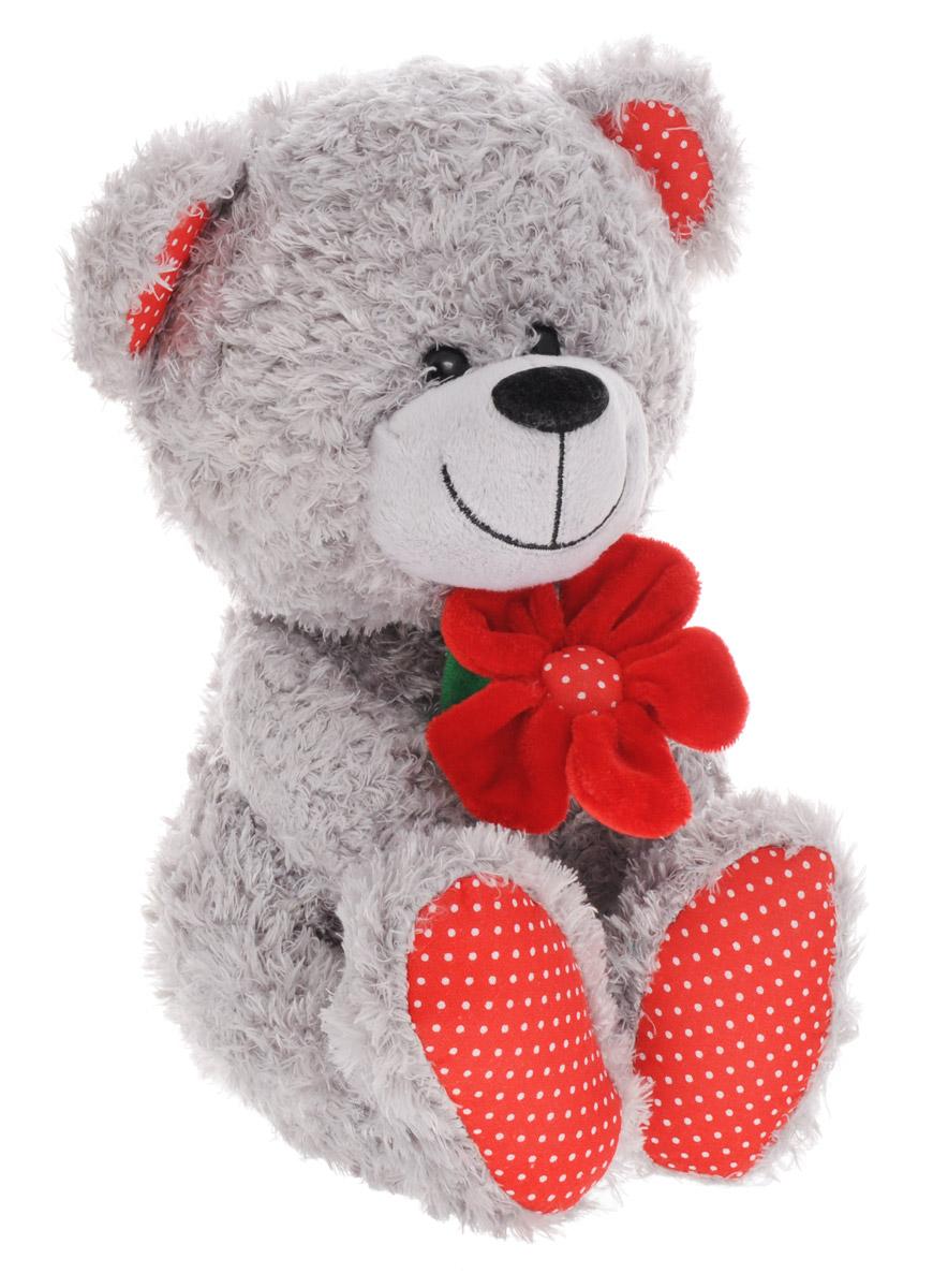 Lava Мягкая игрушка Медведь с красным цветком 24 смLF 1096Очаровательная мягкая игрушка Lava Медведь с красным цветком станет отличным подарком, как для ребенка, так и для взрослого. Плюшевый мишка серого цвета выполнен из качественных и безопасных материалов. У мишки мягкая шерстка, пластиковые глазки черного цвета и аккуратный текстильный носик. В лапках медвежонок держит красный цветочек. Необычайно мягкая игрушка принесет радость и подарит своему обладателю мгновения нежных объятий и приятных воспоминаний.
