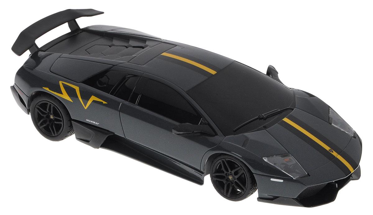 Rastar Радиоуправляемая модель Lamborghini Murcielago LP670-439001Радиоуправляемая модель Rastar Lamborghini Murcielago LP670-4 станет первым гоночным автомобилем вашего малыша. Это точная копия настоящего автомобиля в масштабе 1:24. Юные гонщики оценят эту машину за прекрасные технические характеристики и полную свободу передвижений в любую сторону. Моделью легко управлять и любая гонка принесет удовольствие. Управление машинкой происходит с помощью удобного пульта. Автомобиль двигается вперед и назад, поворачивает направо, налево и останавливается. Автомобиль изготовлен из пластика с металлическими элементами. Колеса игрушки прорезинены и обеспечивают плавный ход, машинка не портит напольное покрытие. Пульт управления работает на частоте 27 MHz. Радиоуправляемые игрушки способствуют развитию координации движений, моторики и ловкости. Ваш ребенок увлеченно будет играть с моделью, придумывая различные истории и устраивая соревнования. Машина работает от 3 батареек типа АА (не входят в комплект). Для работы пульта управления...