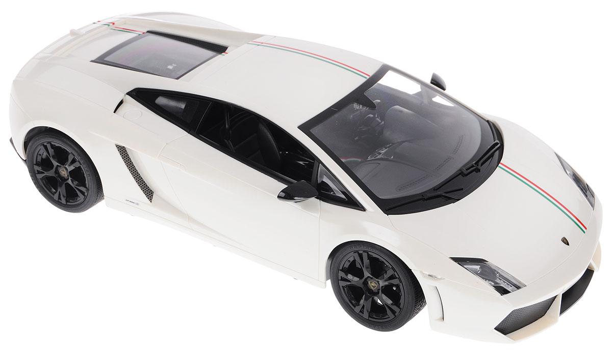 Rastar Радиоуправляемая модель Lamborghini Gallardo LP550-2 Tricolore цвет белый52700_белыйРадиоуправляемая модель Rastar Lamborghini Gallardo LP550-2 Tricolore - это прекрасно смоделированная копия реального автомобиля, которая отличается хорошей детализацией. Модель представлена в масштабе 1/10 и в точности воспроизводит все детали внешнего облика реального автомобиля. Корпус автомобиля выполнен из пластика с использованием металлических элементов, колеса прорезинены. Радиоуправляемые игрушки способствуют развитию координации движений, моторики и ловкости. Ваш ребенок увлеченно будет играть с моделью, придумывая различные истории и устраивая соревнования. Подарите вашему ребенку возможность почувствовать себя настоящим водителем. Машина работает от сменного аккумулятора (входит в комплект). Заряжается при помощи зарядного устройства (входит в комплект). Пульт управления работает от батарейки 9V типа Крона (не входит в комплект).