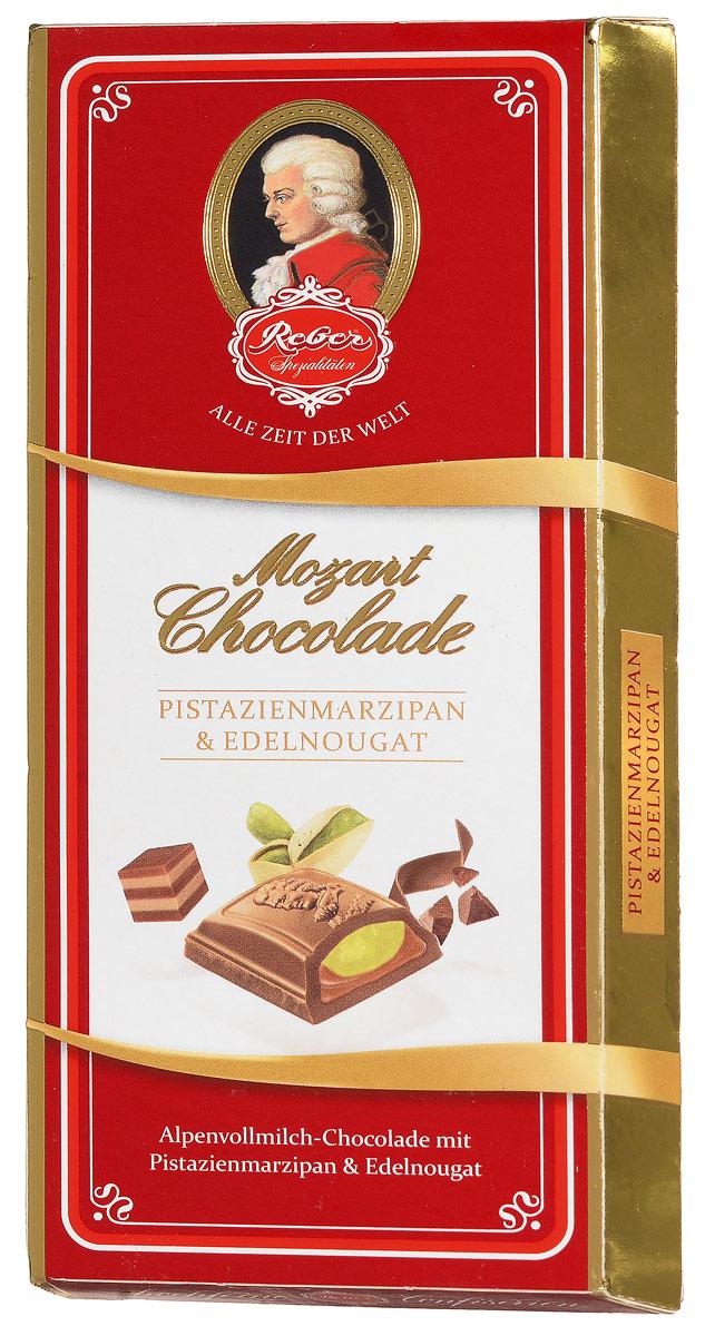 Reber AlpenVollmilch молочный шоколад с ореховым пралине и фисташковым марципаном, 100 г1410133/3Reber AlpenVollmilch - нежный молочный шоколад из альпийского молока с двуслойной начинкой из фисташкового марципана и сладкой нуги из фундука. Марципан уравновешивает сладость нуги и молочного шоколада, поэтому вкус продукта получается сбалансированный, сдержанный и элегантный. Ракушка сделана из довольно толстого слоя шоколада, поэтому она очень приятно ломается, хрустит и сохраняет собственную форму и вкус. Шоколад из альпийского молока приготовлен по семейному рецепту Reber. Нугу делают из средиземноморского медленно обжаренного фундука, сахара, альпийского молока и меда.