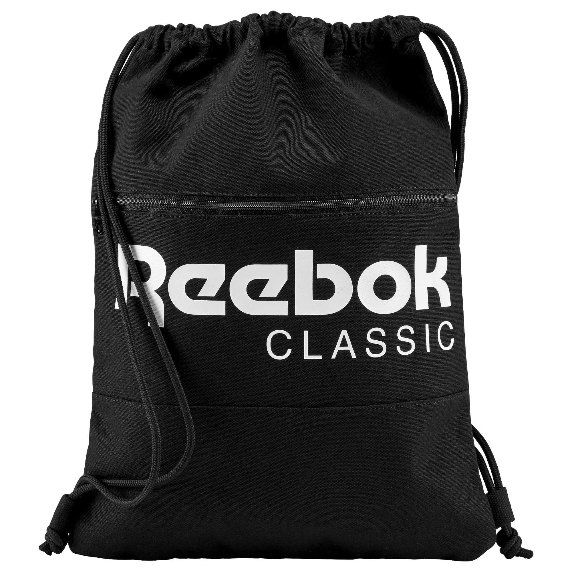 Рюкзак спортивный Reebok Cl Fo Gymsack, цвет: черный. AY0018AY0018Рюкзак спортивный Reebok Cl Fo Gymsack с успехом вместит в себя все необходимое, а в пустом сложенном виде почти не займет места. Потайные карманы отлично подходят для надежного хранения ценных вещей. Модель застегивается на затягивающийся шнурок и дополнена спереди карманом на молнии.