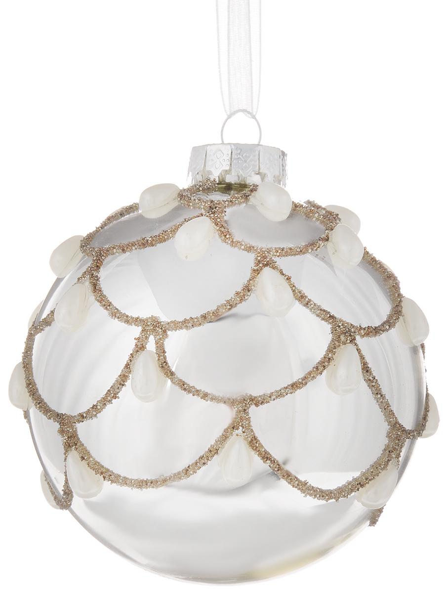 Украшение новогоднее подвесное шар Magic Time Морозные узоры, диаметр 8 см42334Новогоднее подвесное украшение Magic Time Морозные узоры выполнено из стекла в виде шара и декорировано искусственными жемчужинами-капельками. С помощью специальной петельки украшение можно повесить в любом понравившемся вам месте. Но, конечно, удачнее всего оно будет смотреться на праздничной елке. Елочная игрушка - символ Нового года. Она несет в себе волшебство и красоту праздника. Создайте в своем доме атмосферу веселья и радости, украшая новогоднюю елку нарядными игрушками, которые будут из года в год накапливать теплоту воспоминаний. Материал: стекло. Диаметр: 8 см.
