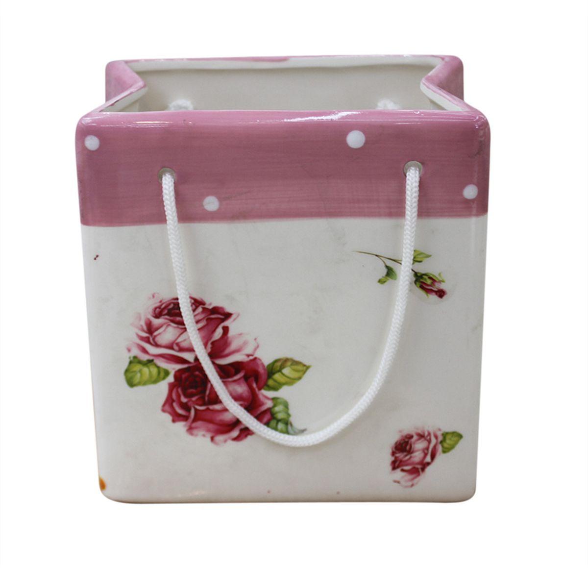 Ваза N/A Пакетик, высота 8,5 смYX12BG38-3RAЭлегантная ваза N/A Пакетик, изготовленная из керамики, выполнена в виде подарочного пакетика с ручками. Такое оформление делает ее изящным украшением интерьера. Ваза N/A Пакетик дополнит интерьер офиса или дома и станет желанным и стильным подарком. Размер вазы: 8 х 5,5 х 8,5 см.