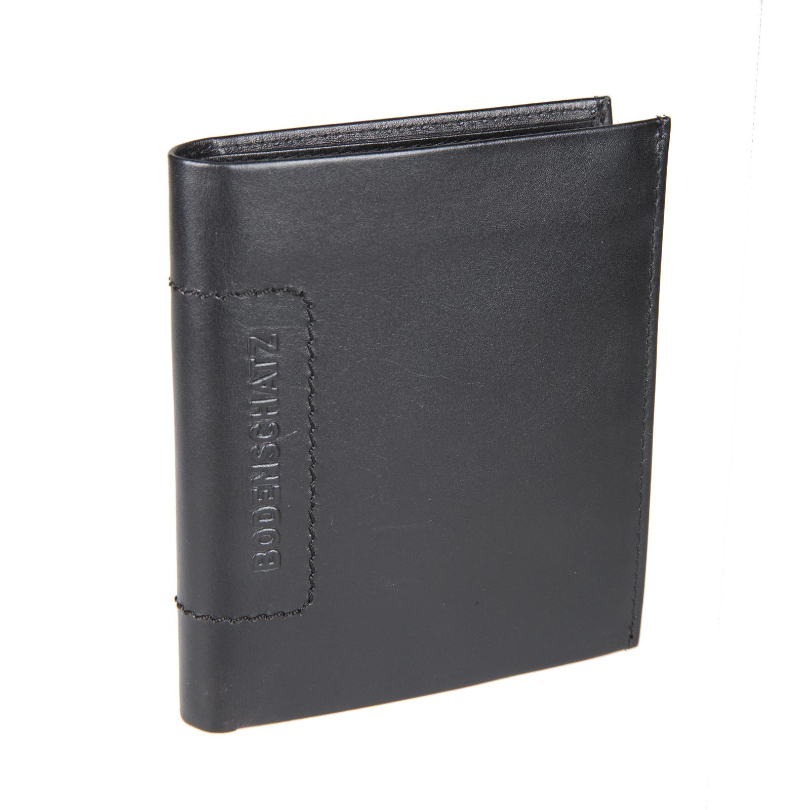 Портмоне мужское Bodenschatz, цвет: черный. 8-503 black8-503 blackРаскладывается пополам, внутри два отдела для купюр, отделение для мелочи закрывается клапаном на кнопке, три потайных кармана, пятнадцать кармашков для пластиковых карт.