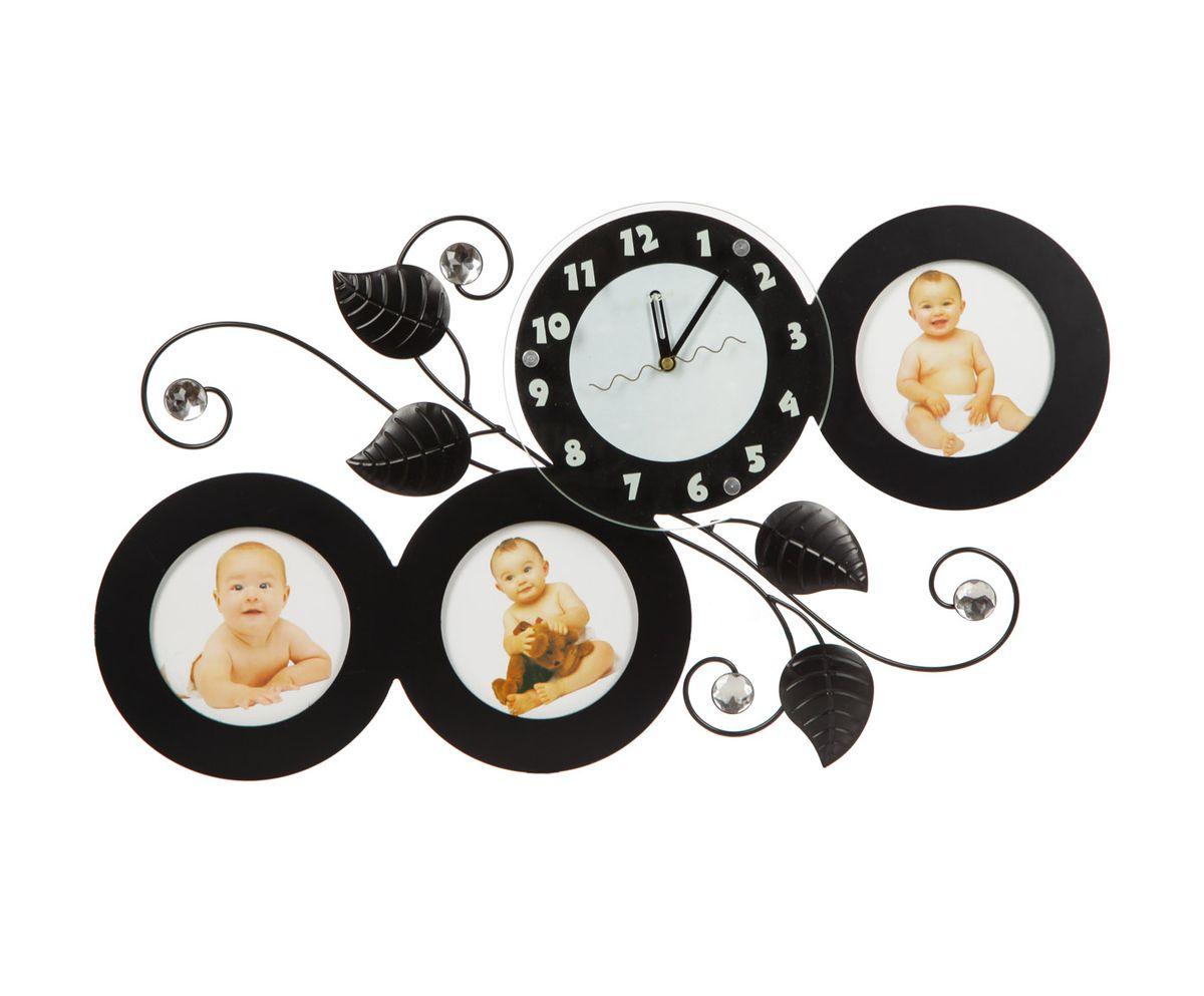 Часы настенные T-Weid, с фоторамками, цвет: черный, 35 х 63 х 5 смM 2067 A BlackНастенные кварцевые часы с фоторамками - это прекрасный предмет декора, а также универсальный подарок практически по любому поводу. Корпус часов, выполнен из дерева с черным матовым покрытием, декорирован изображениями металлических веток с листьями и украшен стразами, так же оформлен тремя круглыми фоторамками. Циферблат часов оснащен тремя фигурными стрелками: часовой, минутной и секундной. Цифры и метки нанесены черной краской на серебристом фоне на внутренней стороне стекла. Циферблат и стрелки защищены прочным стеклом, который крепится четырьмя металлическими крепежами к корпусу. На задней стенке часов расположена металлическая петелька для подвешивания и блок с часовым механизмом. Часы с фоторамками прекрасно впишутся в любой интерьер. В зависимости оттого, что вы поместите в рамки, будет меняться и стиль часов. Тип механизма: плавающий, бесшумный. Рекомендуется докупить батарейку типа АА (не входит в комплект). для 3 фото 13 х 13 см.