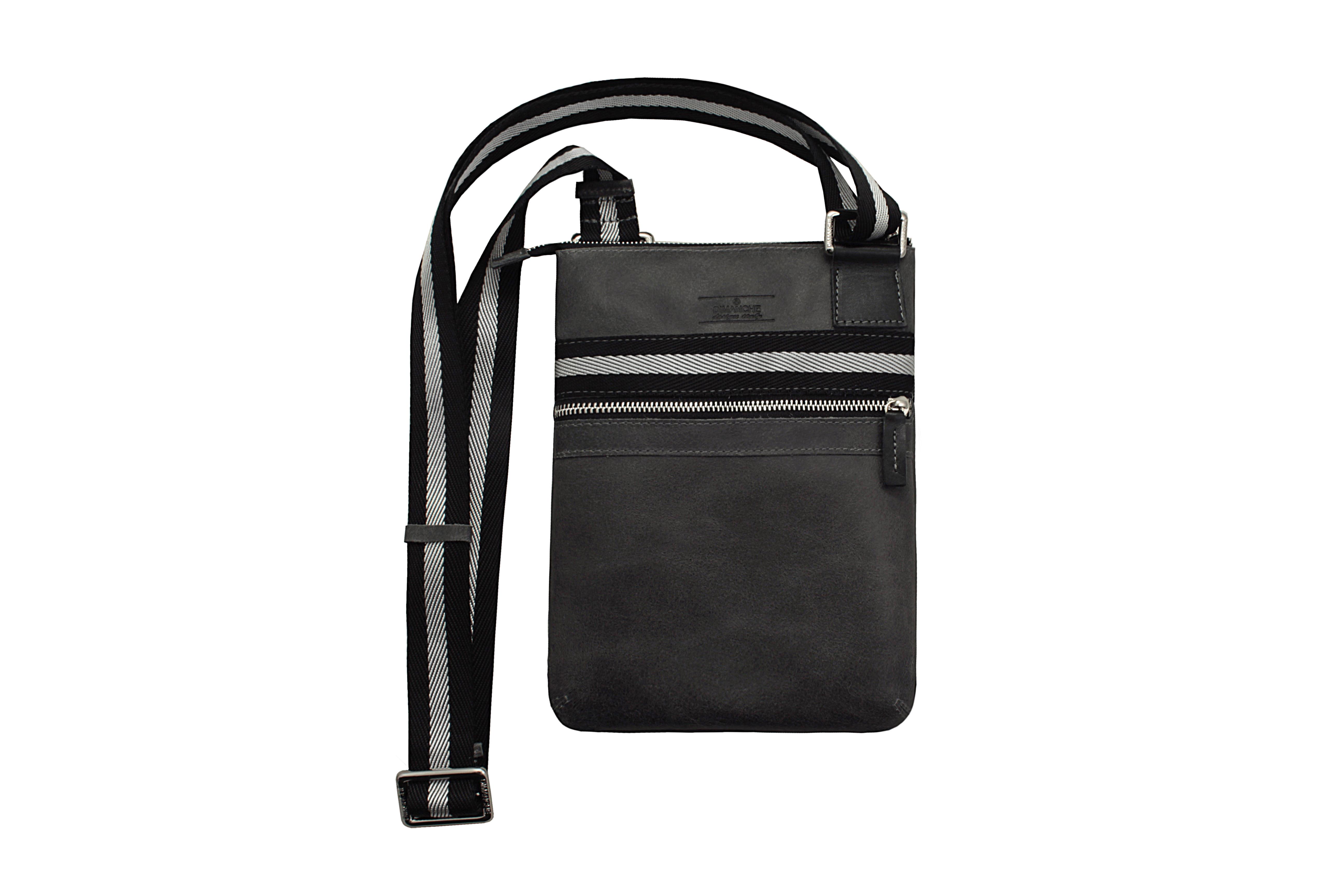 Сумка Dimanche, цвет: черный. 811/36_П811/36_ПСтильная удобная сумка-планшет. Одно отделение на молнии, внутри два кармана (один на молнии, второй открытый). На лицевой стороне есть карман на молнии. Текстильный ремень регулируется по длине.