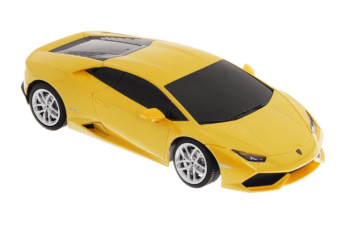 Rastar Радиоуправляемая модель Lamborghini Huracan LP 610-4 цвет желтый71500_желтыйРадиоуправляемая модель Rastar Lamborghini Huracan LP 610-4 является точной уменьшенной копией настоящего автомобиля в масштабе 1/24. Модель привлечет внимание не только ребенка, но и взрослого. Машина при помощи пульта управления движется вперед, дает задний ход, поворачивает влево и вправо. Автомобиль обладает высокой стабильностью движения, что позволяет полностью контролировать его процесс, управляя уверенно и без суеты. Такая машинка станет отличным подарком не только автолюбителю, но и человеку, ценящему оригинальность и изысканность, а качество исполнения представит такой подарок в самом лучшем свете. Подарите вашему ребенку возможность почувствовать себя настоящим водителем. Радиоуправляемые игрушки способствуют развитию координации движений, моторики и ловкости. Машина работает от 3 батареек типа АА (не входят в комплект). Пульт управления работает от 2 батареек типа АА (не входят в комплект). Пульт управления работает на частоте 40 MHz.