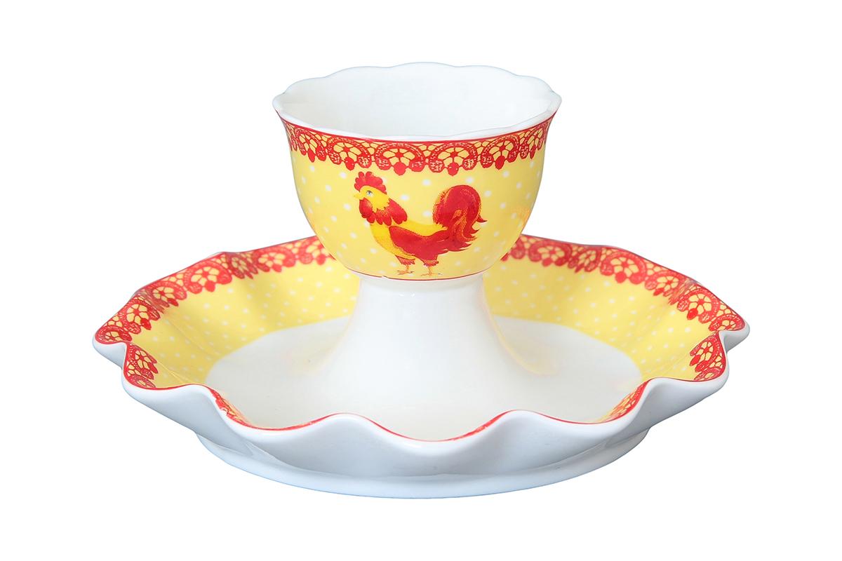 Подставка под яйцо Elan Gallery Петух на желтом фоне с горошком, 25 мл, 11 х 11 х 6 см180886Подставка под яйцо с символом наступающего 2017 года Петухом - это традиционный предмет для завтрака. Красиво смотрится на столе и обязательно придется по вкусу любителям разных интерьерных мелочей. Не рекомендуется применять абразивные моющие средства.