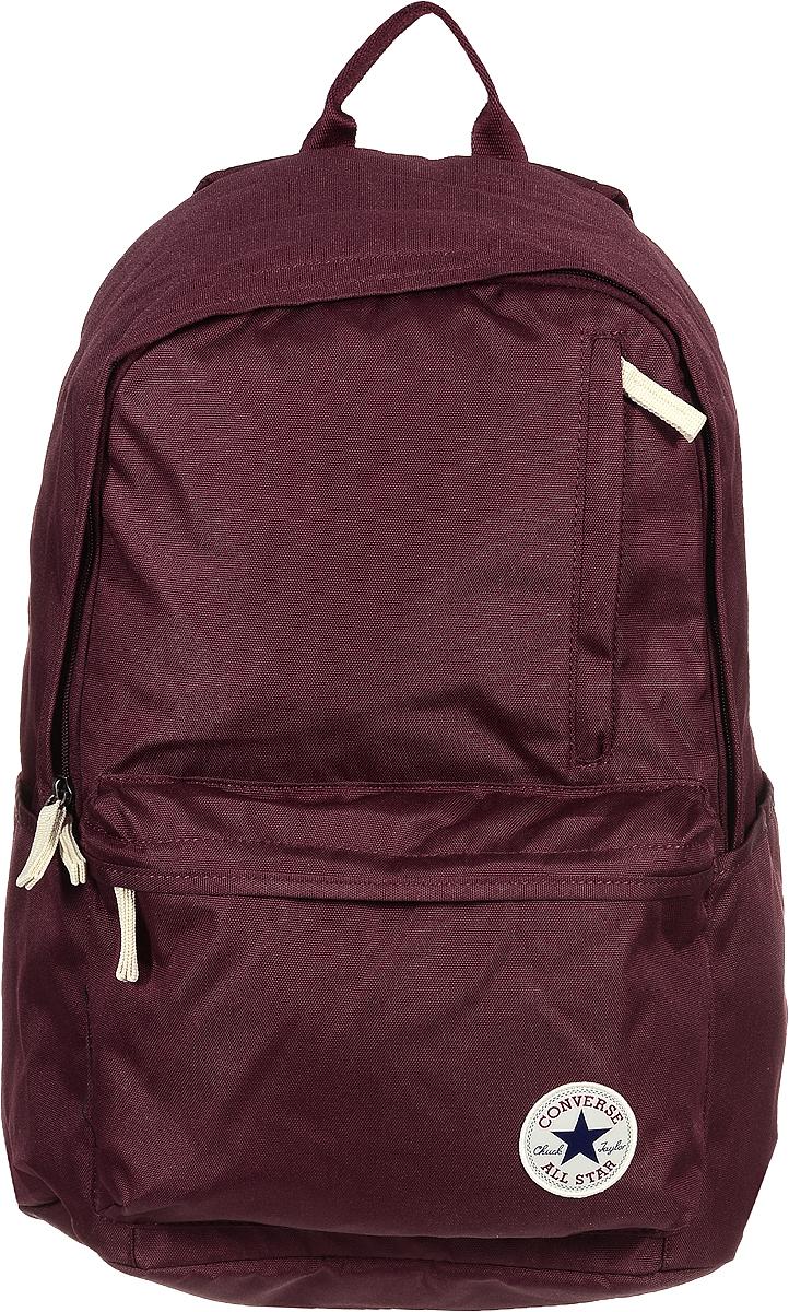 Рюкзак городской Converse Original Backpack (Core), цвет: бордовый. 1000265262510002652625Стильный рюкзак Converse понравится вам с первого взгляда. Он выполнен из высококачественного плотного полиэстера и оформлен фирменной нашивкой. На лицевой стороне расположен удобный накладной карман на молнии и один вертикальный вшитый карман на молнии. Рюкзак оснащен двумя боковыми карманами для бутылок с водой. Изделие закрывается на застежку-молнию. Внутри расположено главное вместительное отделение, которое содержит вшитый карман на молнии для мелочей. Также внутри находится отделение с уплотненной стенкой для ноутбука, закрывающееся хлястиком на застежку-липучку. Такой практичный рюкзак станет незаменимым аксессуаром в вашем гардеробе.