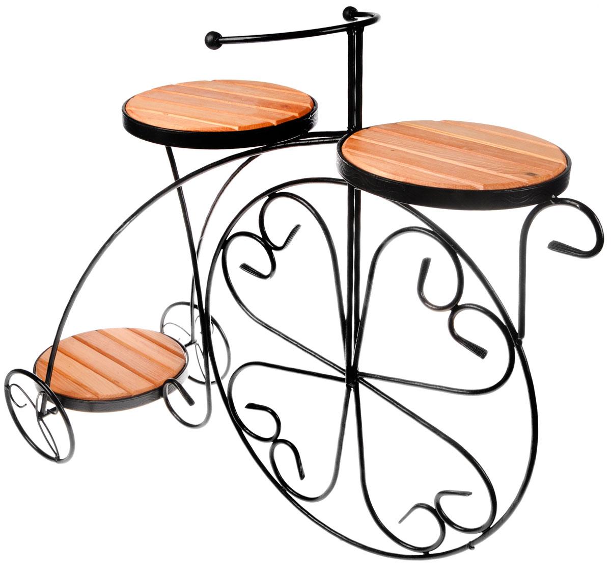 Подставка для цветов Фабрика ковки Велосипед, на 3 цветка, цвет: черный, коричневый. 59-41359-413Оригинальная подставка Фабрика ковки Велосипед предназначена для размещения трех цветков, два размещается на верхнем уровне, один на нижнем. Каркас изготовлен из металла, на котором располагаются полки из дерева. Роль ножек исполняют изогнутые прутки, которые сплетаются в форму, повторяющую форму велосипеда, обеспечивая устойчивое расположение цветков. Подставка станет прекрасным дизайнерским решением для украшения дома. Размер подставки: 81 х 32 х 67 см. Диаметр полок: 23 см.