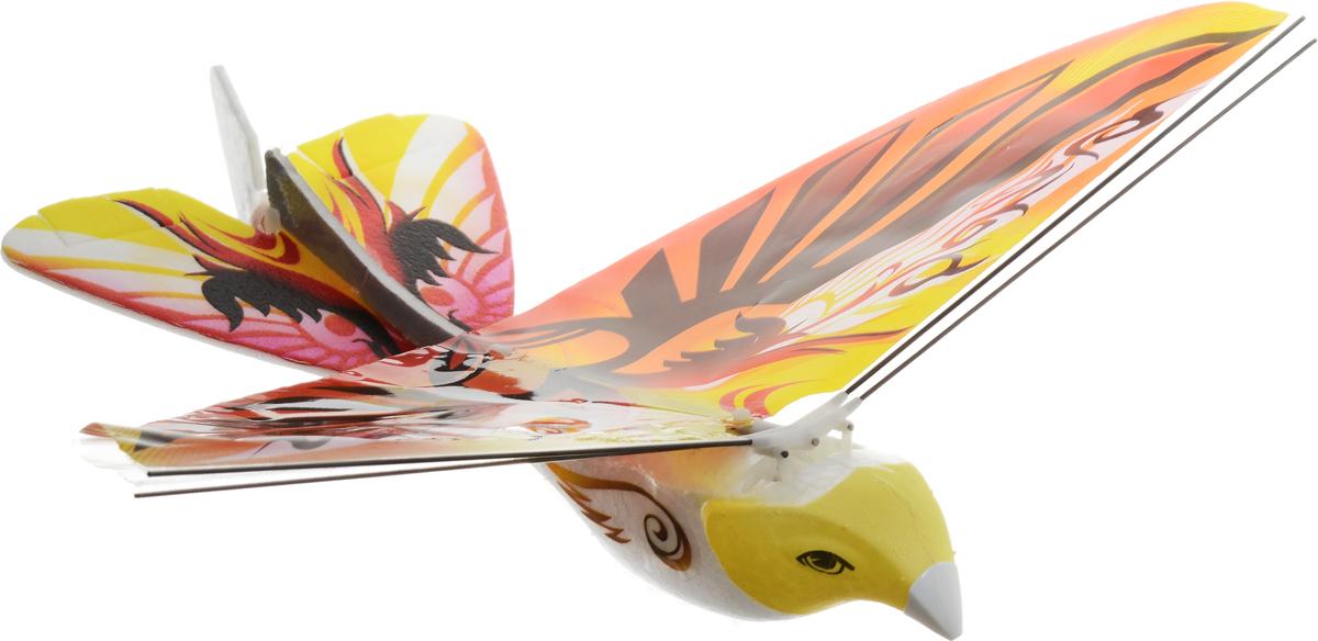 Pilotage Игрушка на радиоуправлении Колибри цвет желтыйRC47805Игрушка на радиоуправлении Колибри представляет собой яркую летающую птичку с пультом радиоуправления. С помощью пульта дистанционного управления можно регулировать частоту взмахов крыльев и направление полета. При максимальной частоте взмахов радиоуправляемая Колибри летит с набором высоты, а если отключить мотор, расправив крылья - Колибри будет планировать. Правой ручкой пульта управления контролируется направление полета. Эта радиоуправляемая пташка в полете очень похожа на настоящую птицу и ведет себя подобно пернатым, что вводит их в недоумение, и они пытаются вашу модель атаковать! Понятное управление игрушкой и её яркий внешний вид, сделают Колибри любимой игрушкой, как для вашего ребенка, так и для вас. Игрушку можно использовать как дома, так и на улице. Возможные движения игрушки: вперед-назад, влево-вправо. Радиоуправляемые игрушки развивают моторику ребенка, его логику, координацию движений и пространственное мышление. Игрушка изготовлена из полимерных...