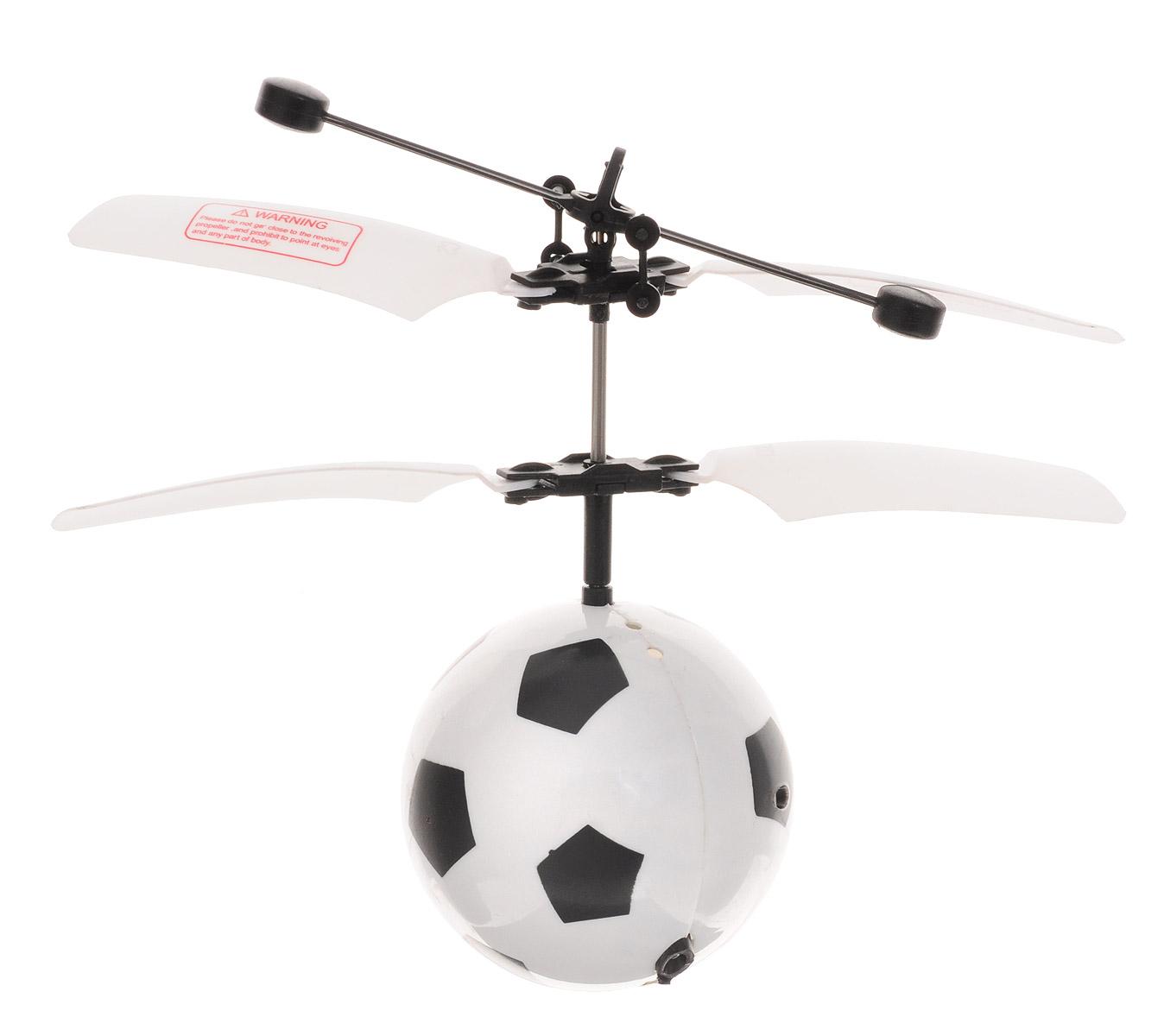 Pilotage Вертолет на радиоуправлении Футбольный мяч RTF цвет белыйRC15817Вертолет на радиоуправлении Pilotage Футбольный мяч RTF станет прекрасным подарком для ребенка или любителя футбола. Модель оснащена соосными роторами, обеспечивающими стабильный полет и вращение модели вокруг своей оси во время полета. В комплекте с летающей моделью мяча вы найдете инфракрасный манипулятор, запускающий лопасти и заряжающий встроенный аккумулятор. Первое нажатие на кнопку манипулятора запускает роторы, а второе останавливает их. Во время полета вы можете управлять его высотой, поднося под мяч руку и предметы, которые определит специальный датчик и повысит обороты роторов. Яркий внешний вид футбольного мяча сделает его любимой игрушкой, как для вашего ребенка, так и для вас. Игрушку можно использовать как дома, так и на улице в безветренную погоду. Радиоуправляемые игрушки развивают моторику ребенка, его логику, координацию движений и пространственное мышление. Игрушка изготовлена из безопасных материалов. Порадуйте своего малыша таким замечательным...