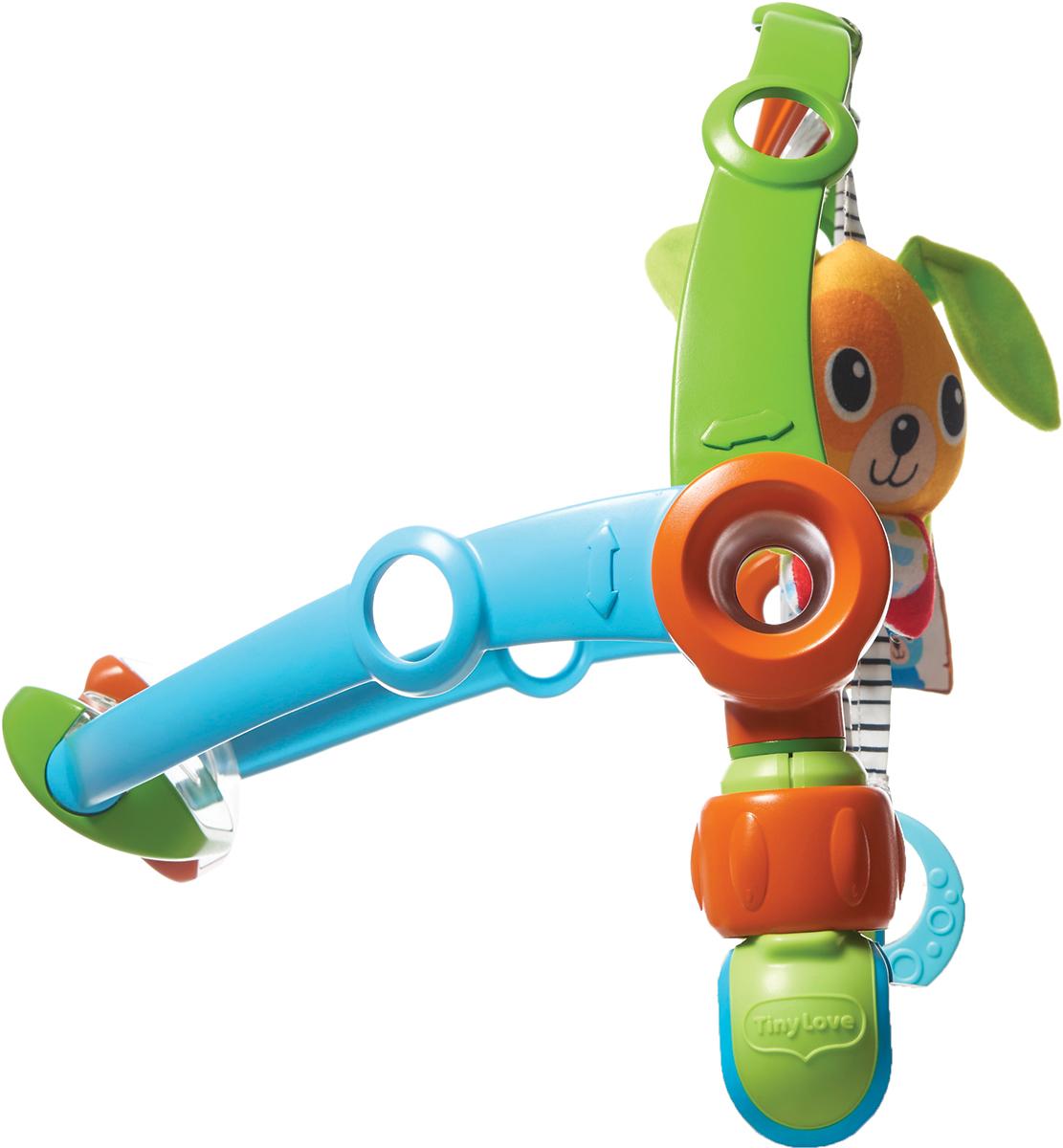 Tiny Love Развивающая дуга Путешествие1403705830Развивающая дуга Tiny Love Путешествие - одновременное развитие ручек и ножек! Дуга легко крепится к коляске и автомобильному креслу. Уклон можно регулировать по удобству ребенка. Зеленая дуга - классическая дуга для развития мелкой моторики, логики и воображения. Содержит развивающие элементы: книжку-шуршалка в виде домика, безопасное зеркало, мягкую игрушку-погремушку с шуршащими ушками, 2 фактурных кольца прорезывателя. Синяя дуга - дополнительная дуга для развития общей моторики и ловкости. Также может быть использована для ручек. Содержит две крутящиеся педали погремушки с рифленой поверхностью. Дуги легко двигаются назад и вперед, что позволяет их подвинуть ближе или дальше от ребенка. Универсальное крепление с нескользящим покрытием позволяет использовать дугу на всех моделях колясок и люлек.