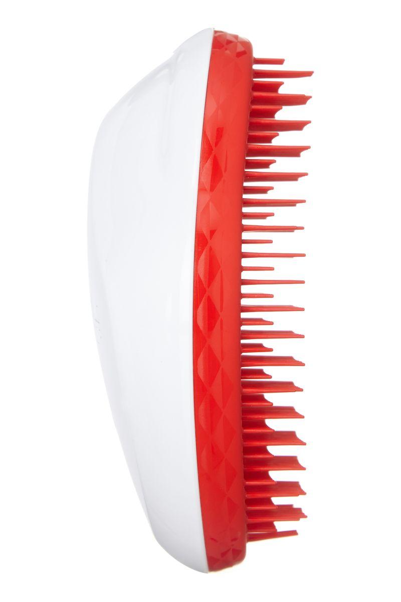 Tangle Teezer Расческа для волос The Original Christmas White/Red373900Tangle Teezer – оригинальная профессиональная расческа для расчесывания волос, которая позволит вам с легкостью всего за одну минуту без рывков и напряжения расчесать мокрые, уязвимые или окрашенные волосы не нарушая структуру волос и не причиняя себе дискомфорта.