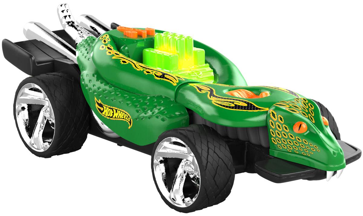 Hot Wheels Машинка TurboaHW90514Машинка Hot Wheels Turboa - желанный подарок для каждого мальчишки. Она выполнена в зеленом агрессивном дизайне в виде змеи с хромированными деталями. Особенностью этой модели является подвижная голова змеи, установленная во фронтальной части машины. Машинка является электромеханической - работает от батареек, запускается в движение при помощи кнопки, находящейся на крыше. Игрушка оснащена звуковыми и световыми эффектами, во время движения поднимается и опускается голова змеи и открывается пасть. Рекомендуется докупить 3 батарейки напряжением 1,5V типа ААА/LR03 (товар комплектуется демонстрационными).