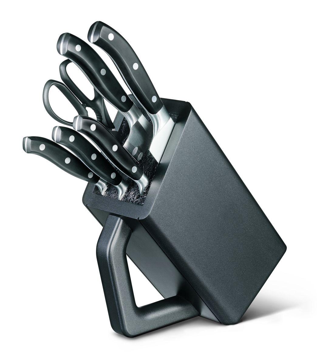 Набор кованых кухонных приборов Victorinox, на подставке, 7 предметов7.7243.6Кованые ножи Victorinox нравятся как любителям, так и профессиональным шеф-поварам. Баланс между рукоятью и лезвием идеально рассчитывается для того, чтобы обеспечить удобство использования даже не протяжение длительного времени работы с ножами. Все модели в данных сериях штампуются из одной детали и имеют бесшовный переход от лезвия к рукояти. Это удивительное качество и неподвластная времени элегантность делают кованые ножи Victorinox такими особенными. У кованых ножей также есть больстер — стальное утолщение в месте, где сходится рукоять и лезвие, он разработан специально, чтобы защитить вашу руку от соскальзывания с рукояти на лезвие. Как правило, ножи данной серии подходят для использования в посудомоечных машинах, тем не менее для увеличения срока службы рекомендуется мыть их в ручную. 6 предметов: - кухонные ножницы (7.6363.3) - нож для чистки овощей (7.7203.06) - нож для стейка (7.7203.12) - универсальный нож (7.7203.15) - нож Сантоку...