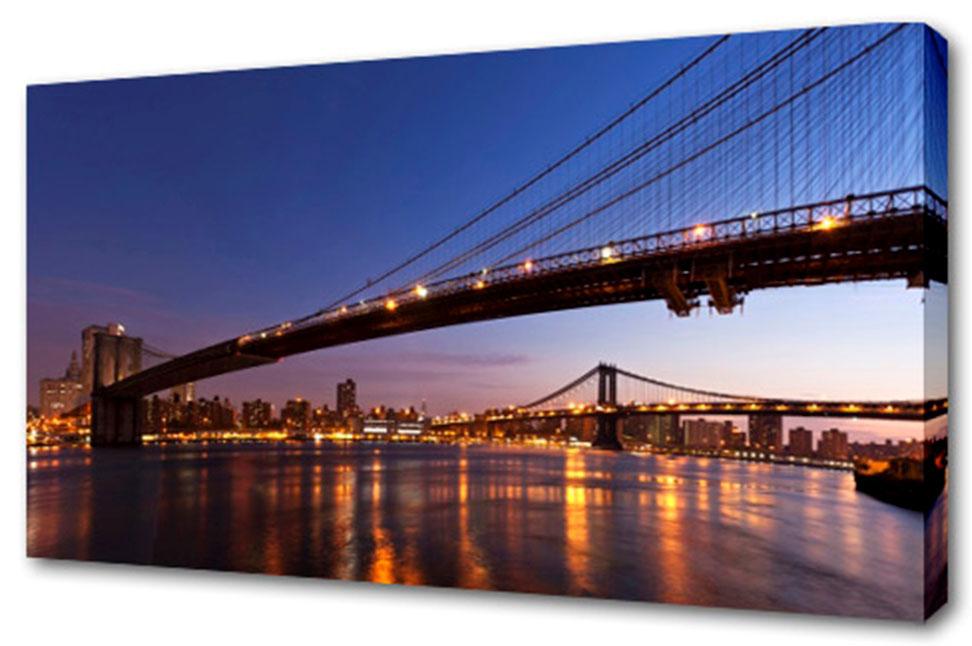 Холст Toplight Город, 100 х 50 см. TL-H3054TL-H3054Холст Toplight Город выполнен из синтетического полотна, подрамник из МДФ. Изделие выглядит очень аккуратно и эстетично благодаря такому способу оформления как галерейная натяжка. Подрамник исключает провисание полотна. Современные технологии, уникальное оборудование и цифровая печать, используемые в производстве, делают постер устойчивым к выцветанию и обеспечивают исключительное качество произведений. Благодаря наличию необходимых креплений в комплекте установка не займет много времени. Холст Topligh - это прекрасная возможность создать яркий акцент при оформлении любого помещения. Правила ухода: можно протирать сухой, мягкой тканью. Толщина подрамника: 3 см.