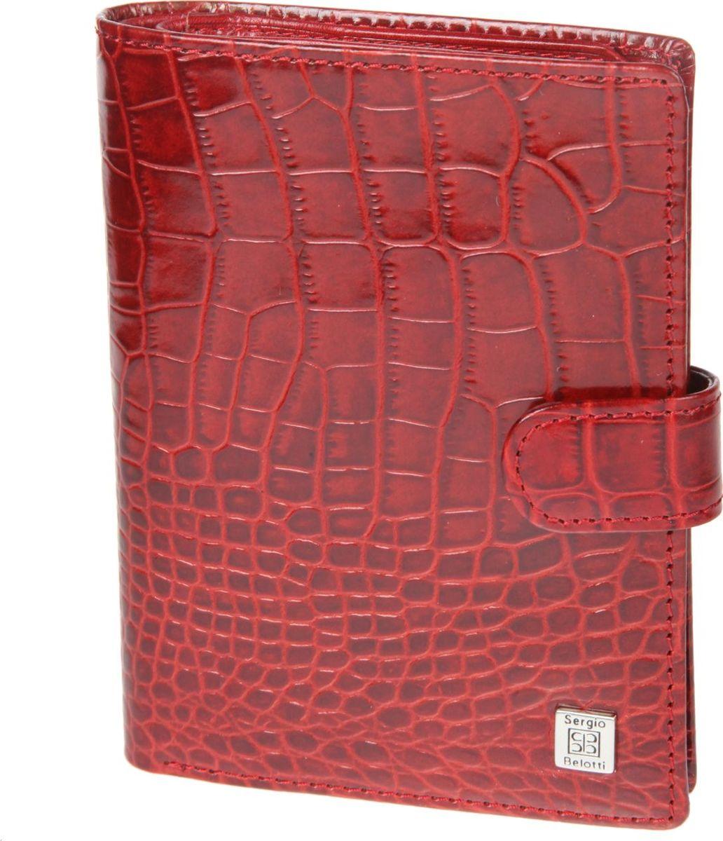 Портмоне женское Sergio Belotti, цвет: красный. 22422242 modena redзакрывается клапаном на кнопке внутри блок прозрачных файлов (шесть листов, один из них формата А5) для автодокументов (водительского удостоверения, техпаспорта, талон ТО, доверенности и т.п.) отделение для паспорта (пластиковая вставка) пять кармашков для пластиковых карт три потайных кармашка отделение для купюр