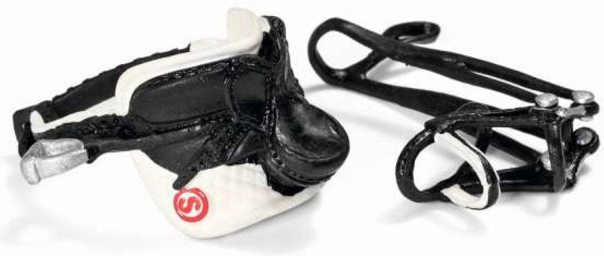 Schleich Дрессировочное седло с уздечкой42125Дрессировочное седло с уздечкой Schleich - прекрасный аксессуар для игрушечных лошадок вашего ребенка. В наборе ребенок найдет специальное седло и уздечку для дрессировок, которые выполнены в черно-белых тонах. Теперь можно устроить веселые и увлекательные скачки! Набор выполнен из качественных и безопасных материалов. Имеет реалистичный внешний вид, приятен на ощупь и позволяет детям играть с большим удовольствием. В процессе манипуляций с миниатюрными игрушками у ребенка развивается мелкая моторика, стимулируются развитие речи, логическое мышление, ребенок знакомится с окружающим миром.