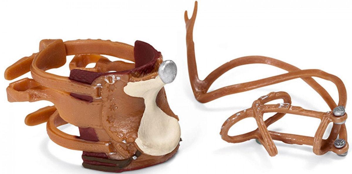 Schleich Ковбойское седло с уздечкой42122Ковбойское седло с уздечкой Schleich разнообразит игры с лошадками вашего ребенка. В наборе ребенок найдет седло для ковбоя и уздечку, которые выполнены в коричневых тонах. Набор выполнен из качественных и безопасных материалов. Имеет реалистичный внешний вид, приятен на ощупь и позволяет детям играть с большим удовольствием. В процессе манипуляций с миниатюрными игрушками у ребенка развивается мелкая моторика, стимулируются развитие речи, логическое мышление, ребенок знакомится с окружающим миром.