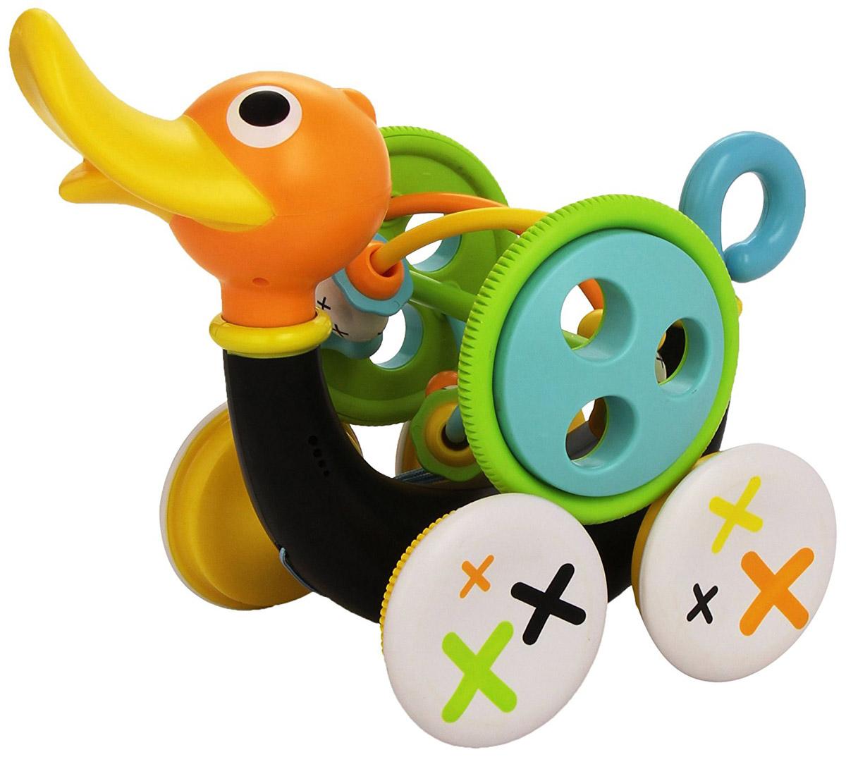 Yookidoo Игрушка развивающая Музыкальная уточка40129С развивающей игрушкой Yookidoo Музыкальная уточка малыш научится совершать свои первые шаги. Игрушка выполнена из прочного безопасного пластика. Ребенок тянет за веревочку (которая располагается в теле уточки), и игрушка едет вперед, при этом она свистит и издает забавные звуки. Звуки включаются только тогда, когда игрушка едет. Для того, чтобы насладиться игрой, малыш должен учиться шагать вперед и при этом тянуть уточку за собой. Если ребенку надоест музыкальное сопровождение, то его можно отключить, повернув хвостик Уточки. Кроме этого, дополнительно в набор входит большая игрушка-погремушка, которая крепится к телу Уточки. Погремушку можно снимать и использовать как отдельную игрушку. На игрушке располагаются различные элементы, которые малыш может перетаскивать пальчиками из стороны в сторону. Музыкальная уточка учит малыша ходить, развивает мелкую моторику рук, логику, слуховое восприятие. Она обязательно понравится малышу и доставит ему...