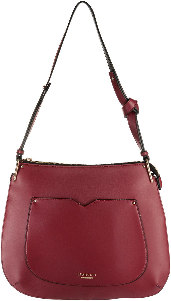 Сумка женская Fiorelli, цвет: красный. 8519 FH8519 FH RedСтильная женская сумка Fiorelli выполнена из мягкой эко-кожи. Сумка имеет одно основное отделение, закрывающееся на застежку-молнию. Внутри находится прорезной карман на застежке-молнии и четыре накладных открытых кармана. Снаружи, на задней стенке размещен прорезной карман на застежке-молнии, спереди накладной открытый карман. Сумка дополнена металлической пластиной с названием бренда. Роскошная сумка внесет элегантные нотки в ваш образ и подчеркнет ваше отменное чувство стиля.