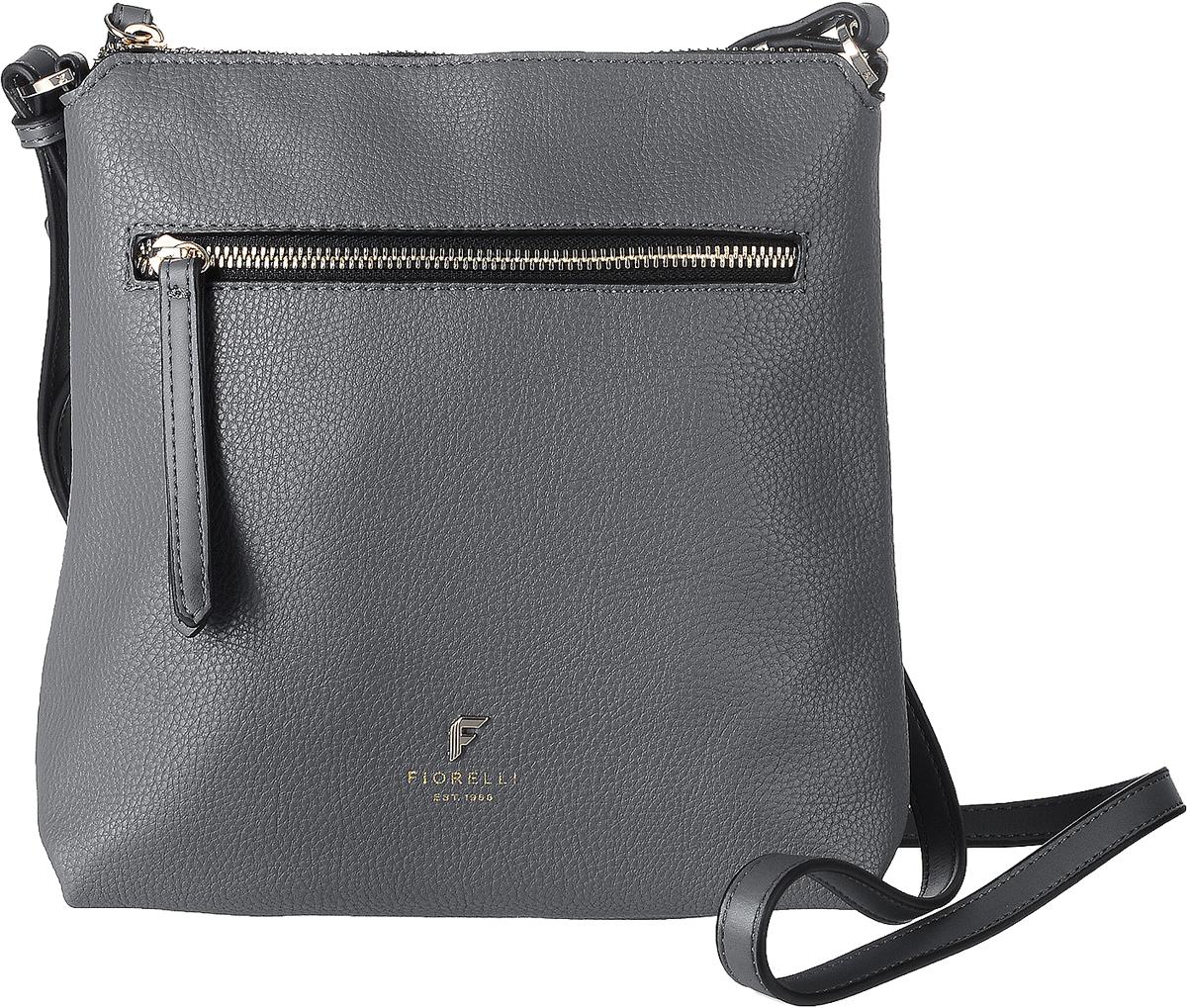 Сумка женская Fiorelli, цвет: серый. 8509 FH8509 FH Grey CasualСтильная сумка Fiorelli выполнена из высококачественной искусственной кожи зернистой текстуры. Изделие оформлено металлической пластинкой с логотипом бренда. На лицевой стороне расположен удобный вшитый карман на молнии. На тыльной стороне расположен открытый накладной карман. Сумка оснащена плечевым ремнем, длина которого регулируется с помощью пряжки. Изделие закрывается на застежку- молнию. Внутри расположено главное отделение, которое содержит один открытый накладной карман и фирменную нашивку.