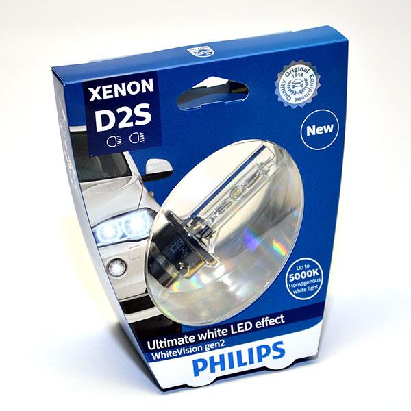 Лампа автомобильная ксеноновая Philips WhiteVision gen2, цоколь D2S, 85 Вт. 85122 WHV2S185122 WHV2S1? Мощный равномерный яркий белый свет ? Идеально сочетается со светодиодным освещением вашей машины ? Белый свет до 5000K на дороге ? Улучшение видимости на 120%* ? Лампа, разрешенная для использования на дорогах общего пользования С лампами Philips Xenon WhiteVision gen2 машина становится более заметной, а освещение дороги более ярким и равномерным. Xenon WhiteVision gen2 — идеальный выбор, если вы хотите сочетать ксенон со светодиодным освещением автомобиля.