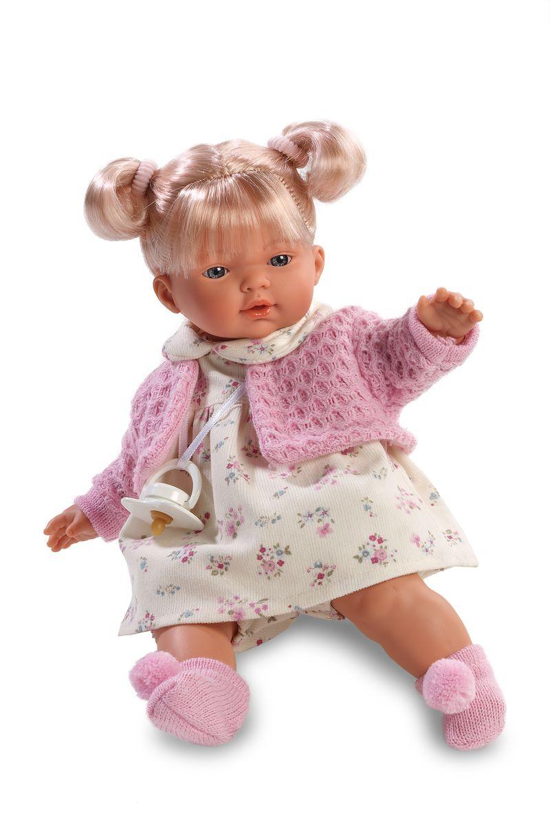 Llorens Кукла Ариана 33 смL 33274Кукла из ПВХ с мягконабивным туловищем с наполнителем из синтетического волокна. Кукла умеет плакать и говорить мама, папа. Одета в светлое платье, розовую кофточку, носочки. К кукле прилагается соска. Если вынуть соску изо рта куклы, то она начинает плакать. Для того чтобы она перестала плакать - поместите соску в рот куклы. Глазки у куклы не закрываются. Упакована в подарочную упаковку.