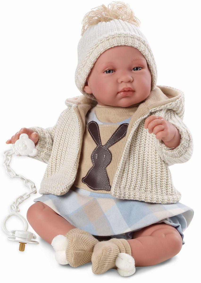 Llorens Кукла-младенец 43 смL 84414Кукла младенец умеет плакать и говорить мама, папа. У куклы очаровательные глаза и одета она в платье, бежевую кофточку, носочки и шапочку. К кукле прилагается соска. Если вынуть соску изо рта куклы, то она начинает плакать. Для того чтобы она перестала плакать поместите соску в рот куклы.