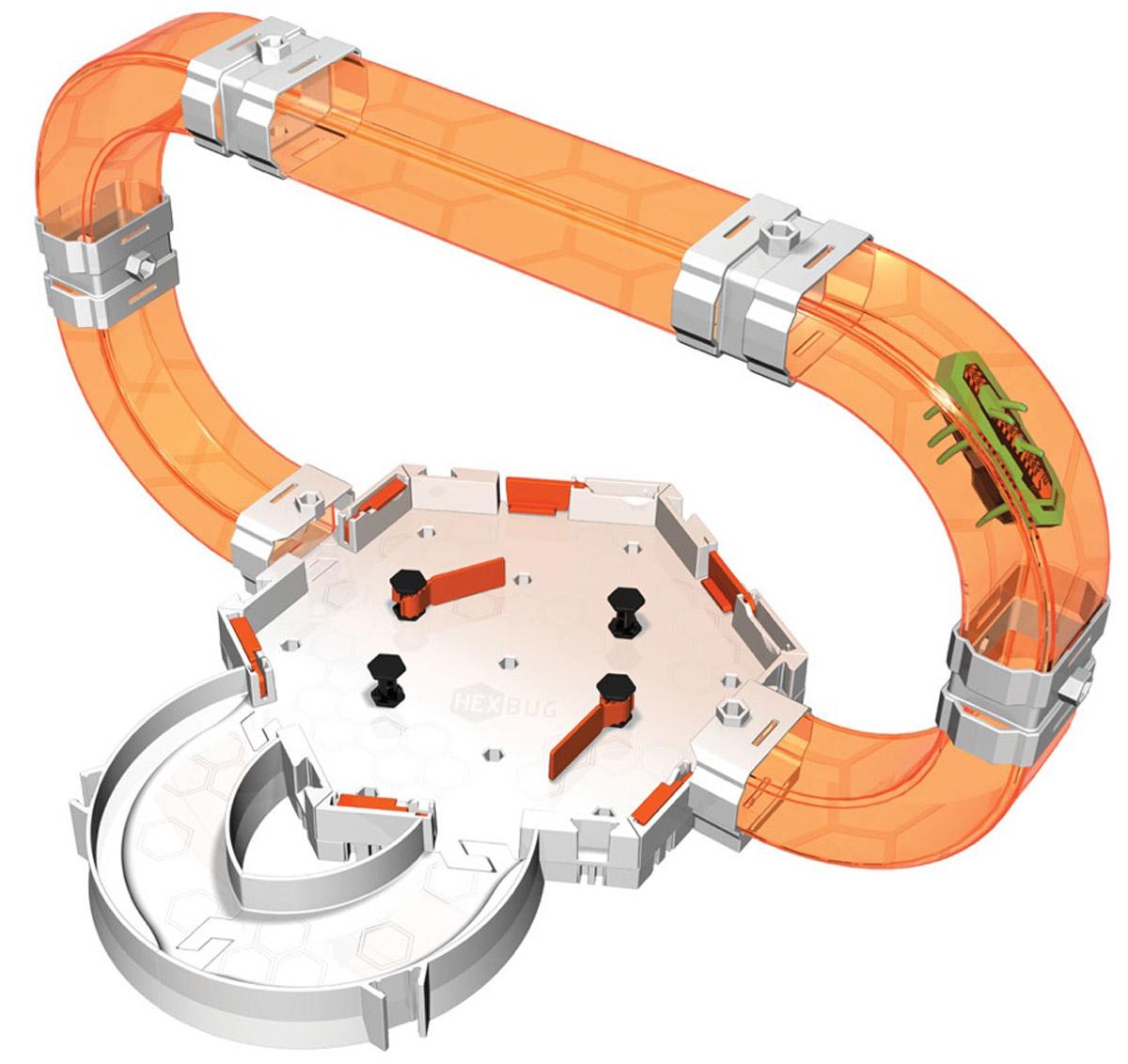 Hexbug Игровой набор Nano V2 Gravity Loop Neon477-4436Игровой набор с микро-роботом Hexbug Нано V2 Gravity Loop Neon - это базовый набор новой серии нанодромов, который дает полное представление о физике передвижения микророботов в трех измерениях. Он также может быть использован для расширения уже существующего лабиринта. Теперь, можно не только наблюдать за тем, как микро-робот исследует лабиринт, но и активно участвовать в его судьбе. Игровой набор содержит 18 элементов для сборки площадки для запуска мини-робота, Nano V2 уникального цвета, фирменная оранжевая шестиугольная площадка с элементами Construct, 4 изогнутых и один прямой прозрачный лаз, два изогнутых поворота для передвижения по горизонтальной поверхности, ну и элементы для сопряжения деталей. Набор совместим с другими игровыми наборами Hexbug Nano V2. Яркий игровой набор станет великолепным дополнением для игр с вашим мини-роботом, он позволит вам посоревноваться в меткости с друзьями или потренироваться в одиночку. Рекомендуется...