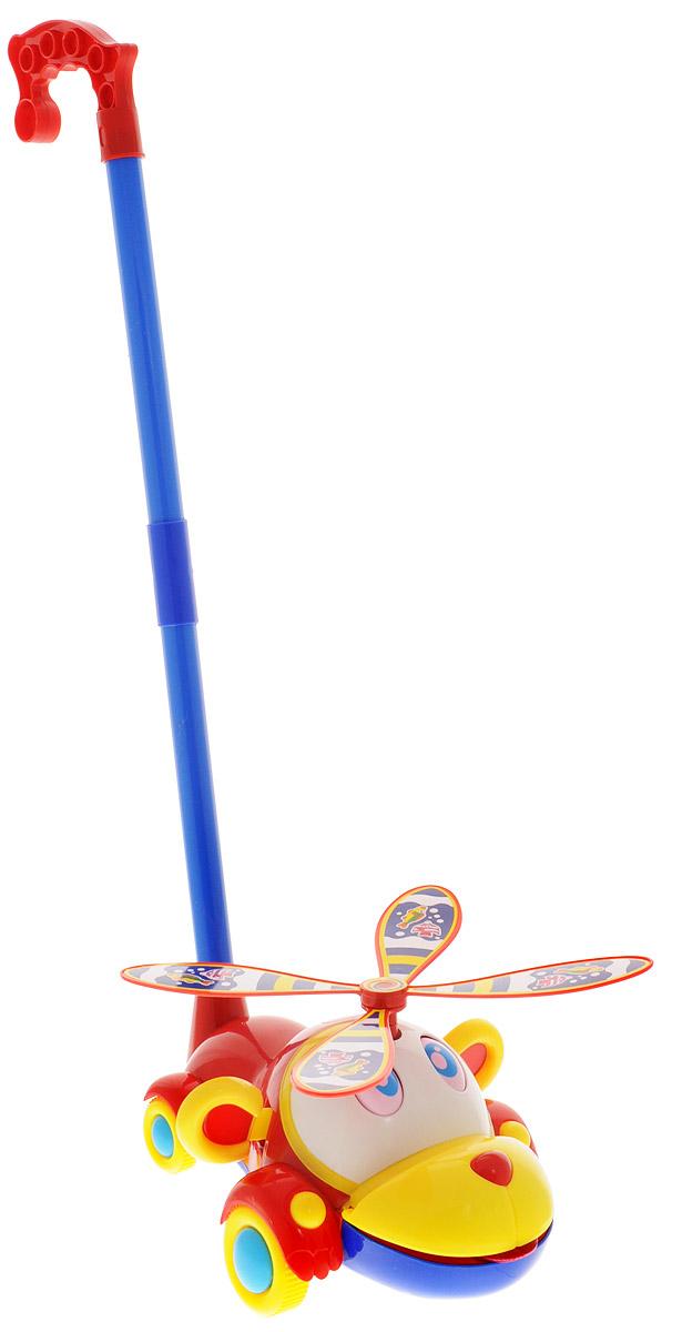 Ami&Co Игрушка-каталка Вертушка цвет красный желтый синий44420_красный/желтый/синийЗабавная игрушка-каталка Ami&Co Вертушка станет любимой игрушкой вашего малыша. Каталка выполнена в виде забавного зверька с пропеллером на голове. К каталке крепится ручка-держатель. При вращении колес пропеллер вращается, ушки и глазки зверька шевелятся, ротик открывается и высовывается язычок. Детская каталка предназначена для малышей, которые уже начали ходить самостоятельно. Яркие, забавные образы принесут радость и веселье во время игр. Игрушка поможет развить координацию движения, тактильные навыки и мелкую моторику рук ребенка, а издаваемые ею звуки активно стимулируют его слух. Порадуйте своего ребенка таким замечательным подарком!