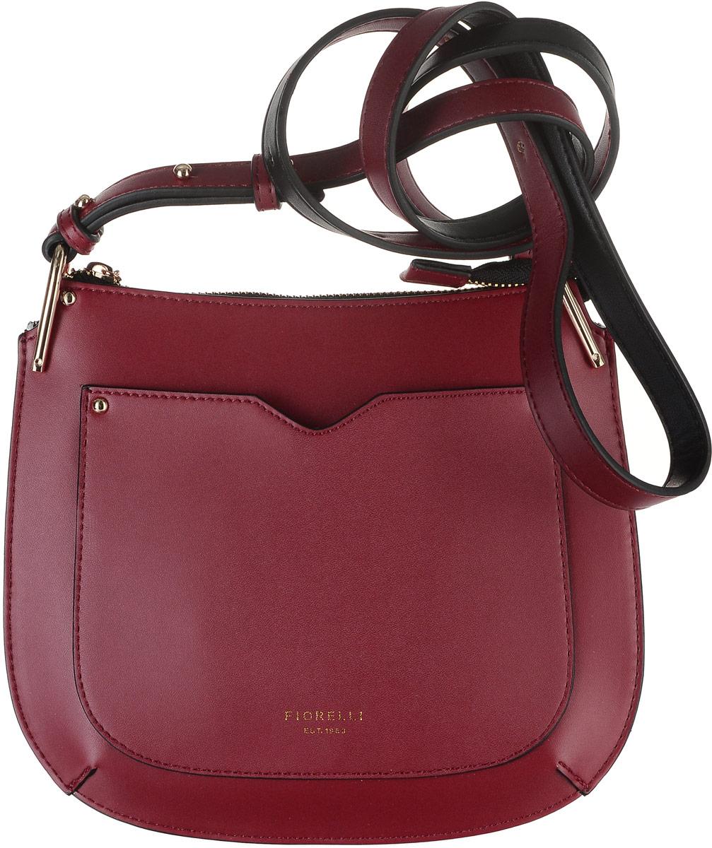 Сумка женская Fiorelli, цвет: красный. 8535 FH8535 FH RedПрактичная маленькая сумка Fiorelli выполнена из приятной на ощупь искусственной кожи и закрывается на застежку-молнию, которая декорирована изящным пулером в виде золотистой цепочки с символикой бренда. Внутренний объем позволяет вместить в аксессуар все необходимое. Модель имеет одно основное отделение, внутри которого находится накладной кармашек для карточек и прочих мелочей. На тыльной стороне изделия имеется накладной карман. Сумка оснащена плечевым ремнем из искусственной кожи. Лаконичный цвет и оригинальная форма помогут этой сумочке вписаться даже в самый сложный и продуманный гардероб. Сумка Fiorelli - идеальный аксессуар вне моды и трендов.