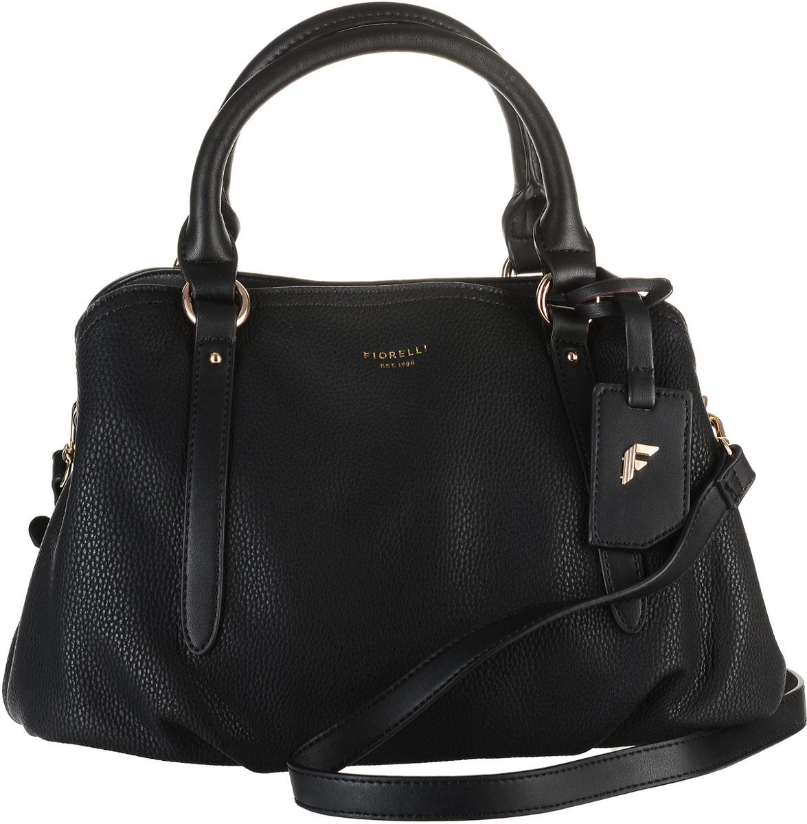 Сумка женская Fiorelli, цвет: черный. 8586 FH8586 FH BlackСтильная женская сумка Fiorelli выполнена из мягкой искусственной кожи с зернистой фактурой, дополнена золотистой фурнитурой и подвеской с символикой бренда. Изделие имеет три вместительных отделения, два из которых закрываются на магнитные застежки, а центральное - на застежку молнию. Внутри имеется прорезной карман на молнии и два открытых пришивных кармана для телефона и мелочей. Сумка оснащена съемным плечевым ремнем из искусственной кожи, который регулируется по длине. Роскошная сумка внесет элегантные нотки в ваш образ и подчеркнет ваше отменное чувство стиля. Дизайн продукции Fiorelli разрабатывается в Лондоне молодой, амбициозной командой, идущей в ногу со временем и предлагающей модели, которые предназначены для любых случаев, как для выхода в свет, так и для рабочих будней, торжественных приемов или коктейльных вечеринок.