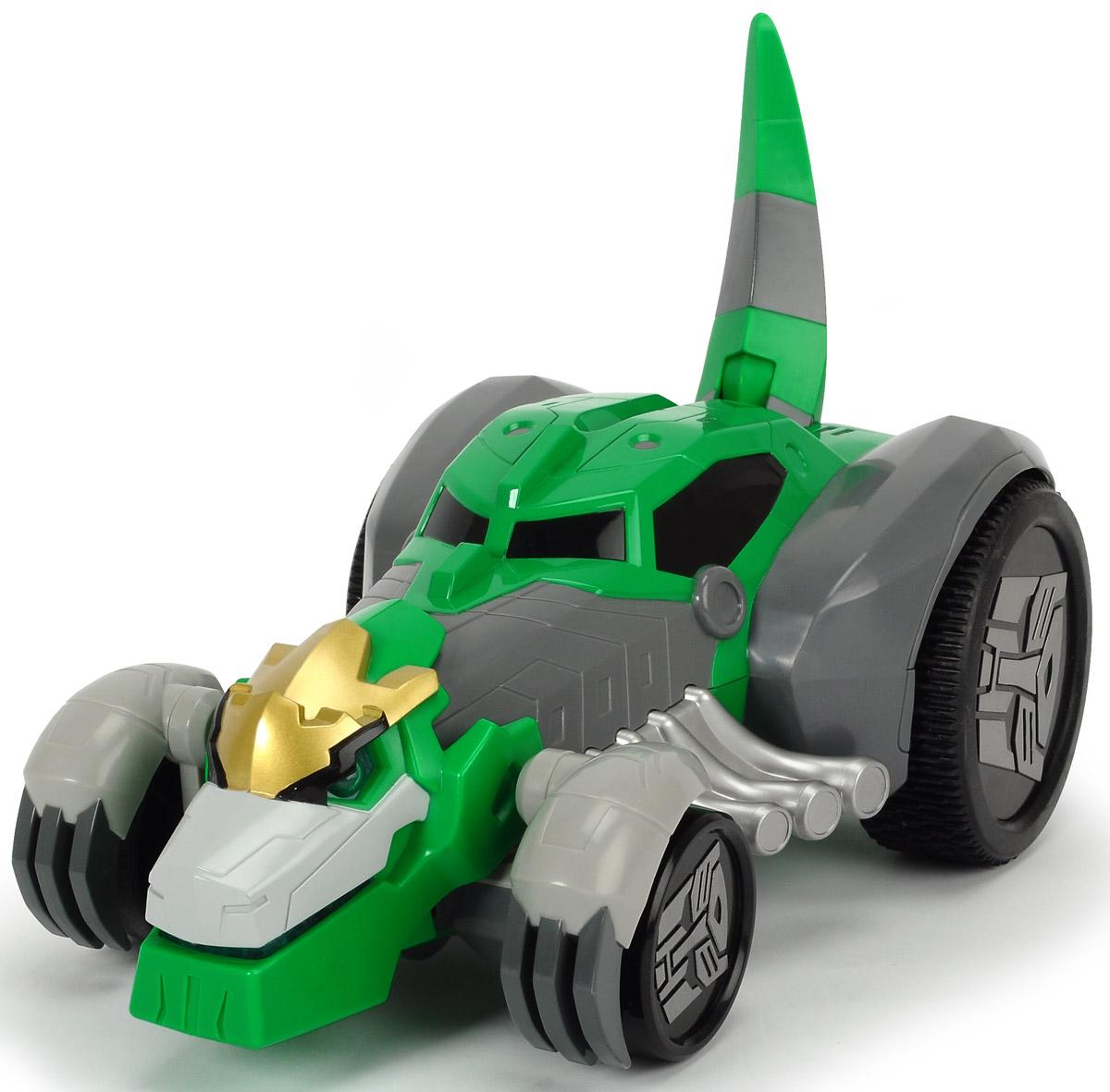 Dickie Toys Машина-трансформер на радиоуправлении Grimlock3116000Машинка-трансформер Dickie Toys Grimlock - это необычная машинка, которая с помощью одной кнопки превращается в трансформера- динозавра Grimlock из мультфильма Трансформеры. Роботы под прикрытием. Главной особенностью персонажа этого популярного мультфильма по имени Гримлок была его трансформация из огромного динозавра в быстрый гоночный автомобиль, который не давал противнику шансов, уйти от погони. Теперь это настоящий боевой трансформер, который может ездить на задних колесах вперед и назад, налево и направо. Машинка имеет режим турбо, в котором достигает скорости до 8 км/ч. Пульт управления имеет световые и звуковые эффекты, а так же складывается и раскладывается. Время работы аккумулятора 30 минут, а время полной зарядки аккумулятора 120 минут. Машинка дополнена вращающимися колесами, диски которых украшены символикой трансформеров. Эта игрушка станет главным действующим лицом увлекательной игры, а ваш ребенок сможет придумать новую историю, проявив свою...