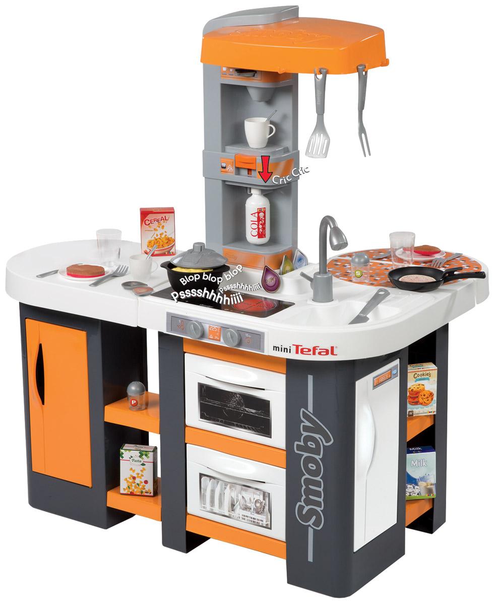 Smoby Игрушечная кухня Studio XL311002Высококачественная игрушечная кухня Smoby Studio XL - прекрасный игровой комплект с многочисленными приборами и аксессуарами, которые позволят ребенку играть одному, подражая родителям или в компании с друзьями, придумывая интересные сюжеты для командной игры и распределяя обязанности по приготовлению блюд между собой. Кухня имеет несколько игровых зон и укомплектована мойкой, плитой с вытяжкой, холодильником, посудомоечной машиной и другими необходимыми приспособлениями. Благодаря дополнительным аксессуарам дети могут печь волшебные блинчики. Мясо и рыба имеют две разные стороны - одна сырую и другая жаренную, что сделает игру более реалистичной. К рабочим поверхностям кухни можно подойти со всех сторон, что позволяет играть в компании со своими друзьями. Тематический комплект имеет несколько игровых зон с функциональными дверцами, полочками для посуды и посудой в комплекте. Игровой процесс сопровождается реалистичными звуковыми эффектами - приготовление пищи или журчание...