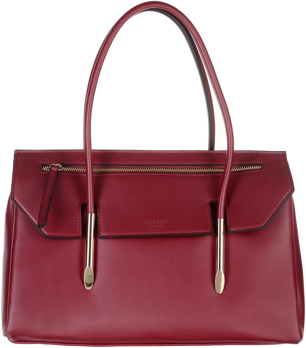 Сумка женская Fiorelli, цвет: темно-красный. 8503 FH8503 FH RedСтильная сумка Fiorelli выполнена из высококачественной искусственной кожи и оформлена фирменной надписью и металлической пластинкой с логотипом бренда. На лицевой стороне расположен декоративный карман на молнии. На тыльной стороне расположен небольшой открытый накладной карман. Сумка оснащена удобными ручками и металлическими ножками, которые предотвратят повреждение дна сумки. Изделие закрывается клапаном на магнитную кнопку. Внутри расположено главное вместительное отделение, которое разделяет карман-средник на молнии. Также внутри находятся четыре открытых накладных кармана для телефона и мелочей и один вшитый карман на молнии.