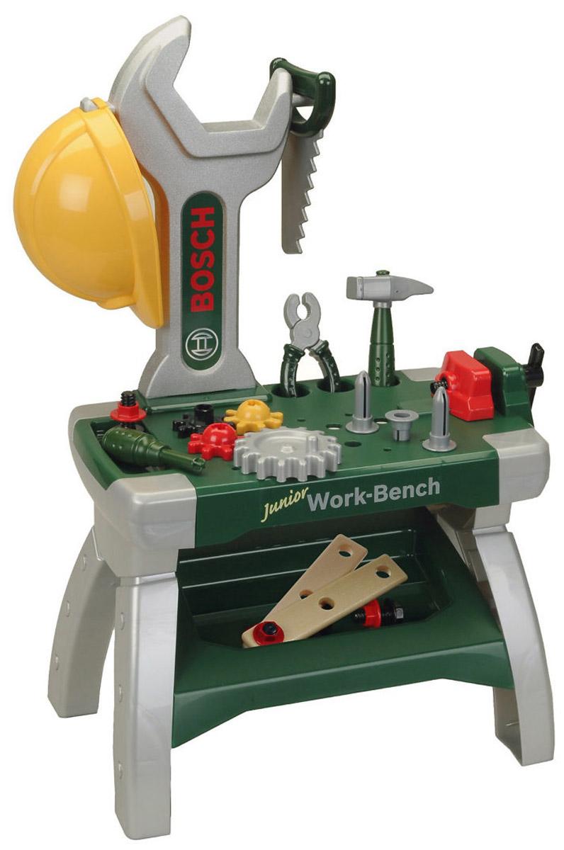Klein Игрушечный верстак с инструментами Bosch Junior-Workbench8604Игрушечный верстак с инструментами Klein Bosch Junior-Workbench - отличное начало для детской мастерской. Здесь имеется все необходимое, чтобы проводить игрушечные ремонтные работы, а выглядят инструменты так правдоподобно, что их несложно перепутать с папиными. В комплекте с верстаком множество аксессуаров: 4 шестерни, 3 болта с гайками, 3 дюбеля, плоскогубцы, отвертка, молоток, пила, 2 планки с отверстиями для закрутки болтов и каска на голову, а еще здесь имеются тиски. Все элементы набора выполнены из безопасного для ребенка материала.