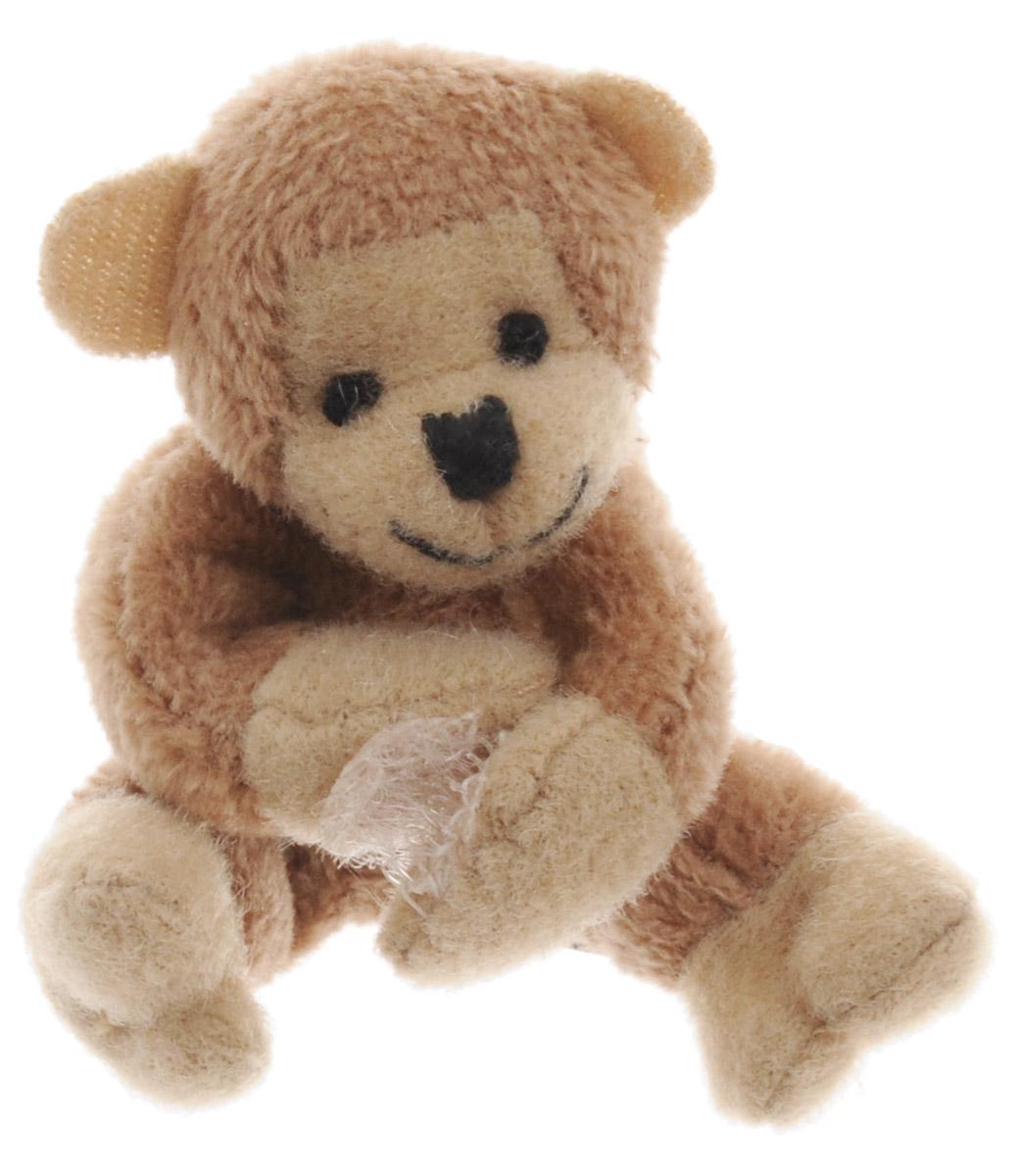 Beanzees Мягкая игрушка Обезьянка Magoo 5 смB31001_7_коричневая обезьянкаСимпатичная миниатюрная мягкая игрушка Beanzees Обезьянка Magoo - это игрушка три в одном. Ее приятно держать в руках, увлекательно коллекционировать, а также эти игрушки можно соединять между собой с помощью липучек и носить как оригинальное украшение на шею или на руку. По легенде эти крошечные животные обитают все вместе в волшебном лесу под названием Бинзилэнд, в котором всегда ярко светит солнышко и цветут цветы. Размер игрушки 5 см, она выполнена из мягкого гипоаллергенного материала, набивка - синтетическое волокно, в том числе специальные пластиковые гранулы, делающие эту игрушку замечательным антистрессом. На лапках обезьянки располагаются маленькие текстильные липучки, с помощью которых игрушку можно соединять с другими.