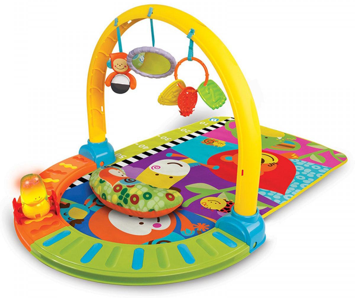 B kids Развивающий коврик004897Развивающий коврик с эффектами от B kids - красивый и функциональный элемент, который должен быть в каждой детской. Он предоставляет сразу пять вариантов использования, рассчитанных на пять разных этапов развития ребенка. Коврик можно использовать: Лежа на спине (для самых маленьких: можно рассматривать подвешенные на дуге игрушки, а потом и доставать их руками); Лежа на животе (для тех, кто уже научился привставать на руках: можно наблюдать за гусеницей со световыми и звуковыми эффектами, которая перемещается по дорожке, и продолжать изучать игрушки, которые сняли с дуги); Сидя и ползая (более взрослые малыши могут проводить время на коврике, полностью осваивая его пространство и все игрушки); Идя по дорожке (полукруг, по которому передвигалась гусеница в этапе 2, может быть снят с коврика и транформирован в дорожку, по которой теперь ходит малыш); Меряя рост (снимите с коврика все детали и закрепите его полотно на стене;...