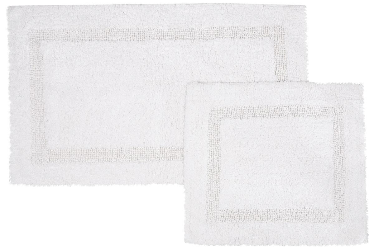 Набор ковриков для ванной Modalin Karla, цвет: белый, 2 шт5027/CHAR002Набор Modalin Karla, выполненный из высококачественного хлопка, состоит из двух ковриков для ванной комнаты. Изделия добавят тепло и уют, а также внесут неповторимый колорит в интерьер ванной комнаты. Высокая износостойкость ковриков и стойкость цвета позволит вам наслаждаться покупкой долгие годы. Размер большего коврика: 60 х 100 см. Размер малого коврика: 60 х 50 см.